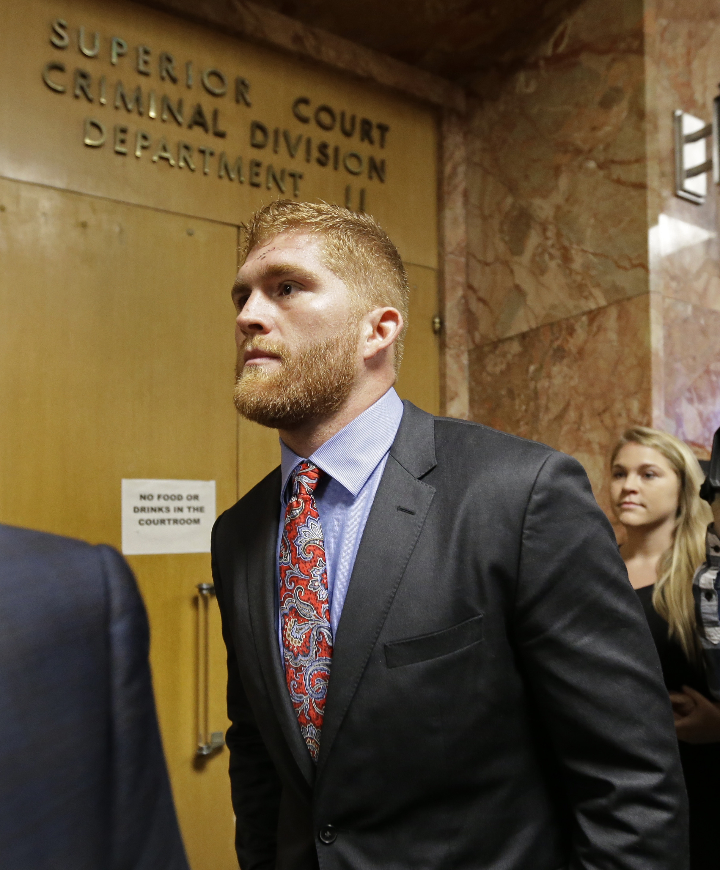 Former San Francisco 49ers' Bruce Miller waits to enter San Francisco County Superior Court, Friday, Sept. 9, 2016, in San Francisco. Prosecutors charged Miller with seven felonies, including assault with a deadly weapon, stemming from Monday's alleged dr