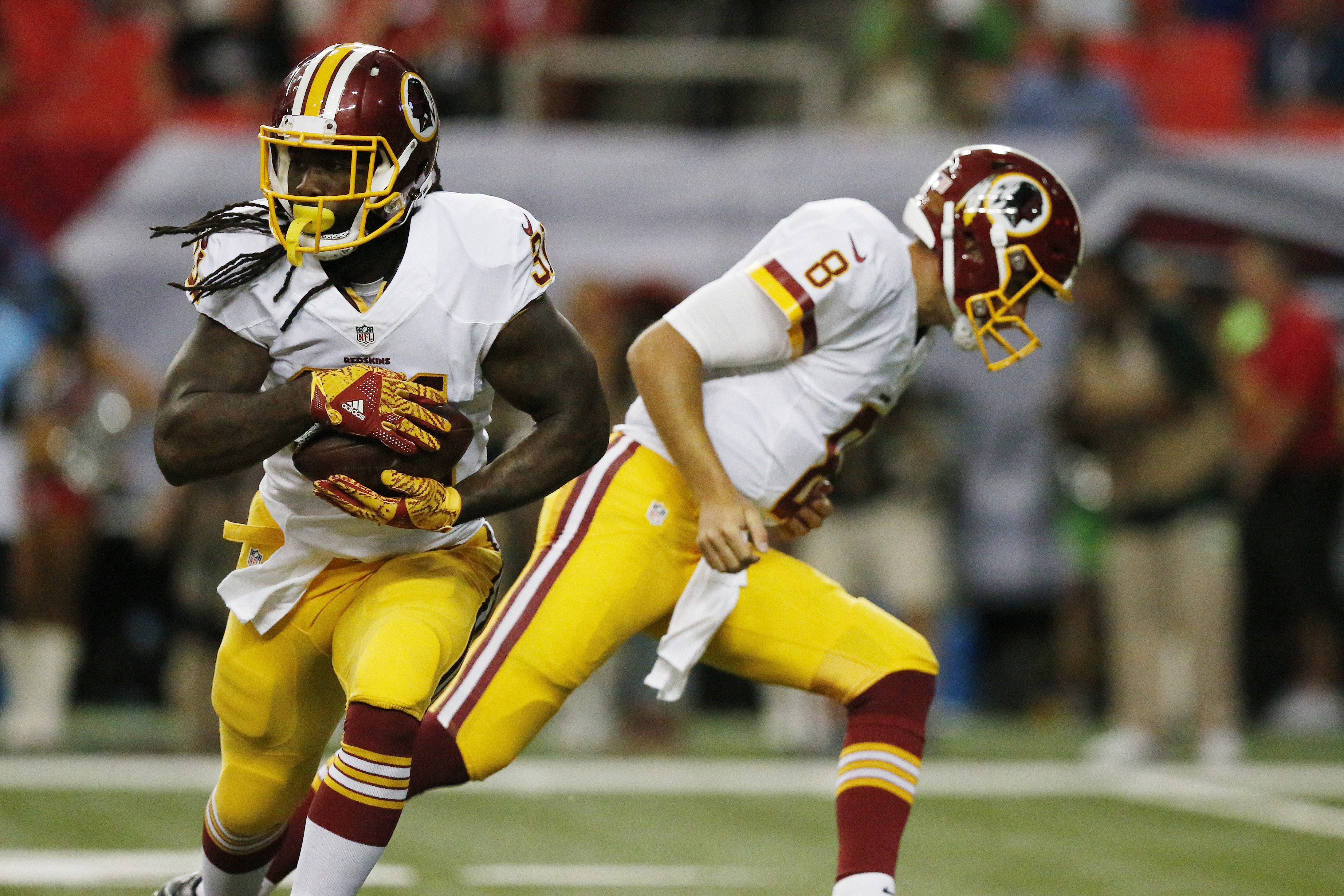 FILE - In this Aug. 11, 2016, file photo, Washington Redskins running back Matt Jones (31) runs the ball against the Atlanta Falcons during the first half of a preseason NFL football game in Atlanta. Jones expects to play for the  Redskins in their season