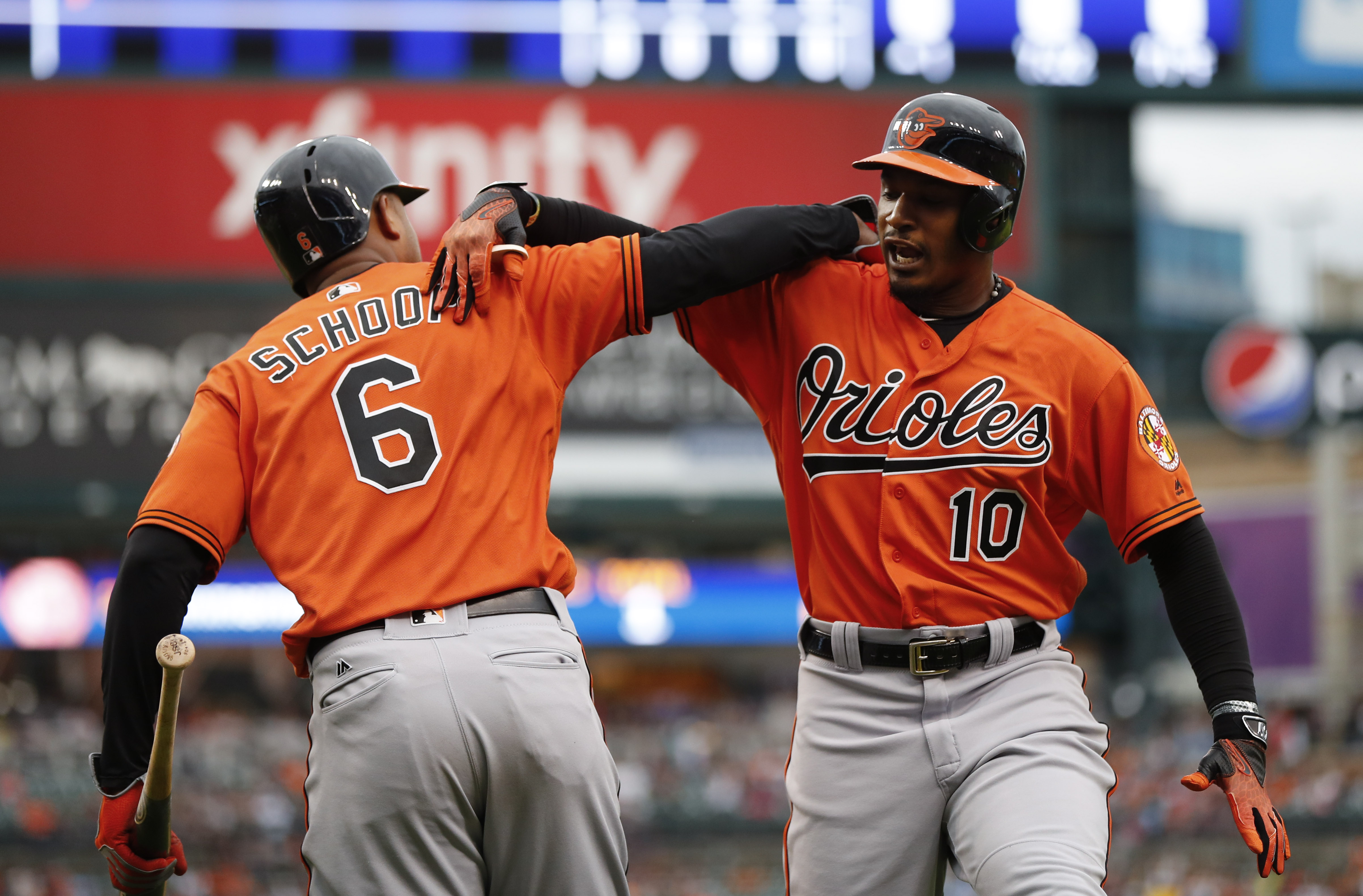 Baltimore Orioles' Adam Jones (10) celebrates his solo home run with Jonathan Schoop (6) against the Detroit Tigers in the first inning in Detroit, Saturday, Sept. 10, 2016. (AP Photo/Paul Sancya)