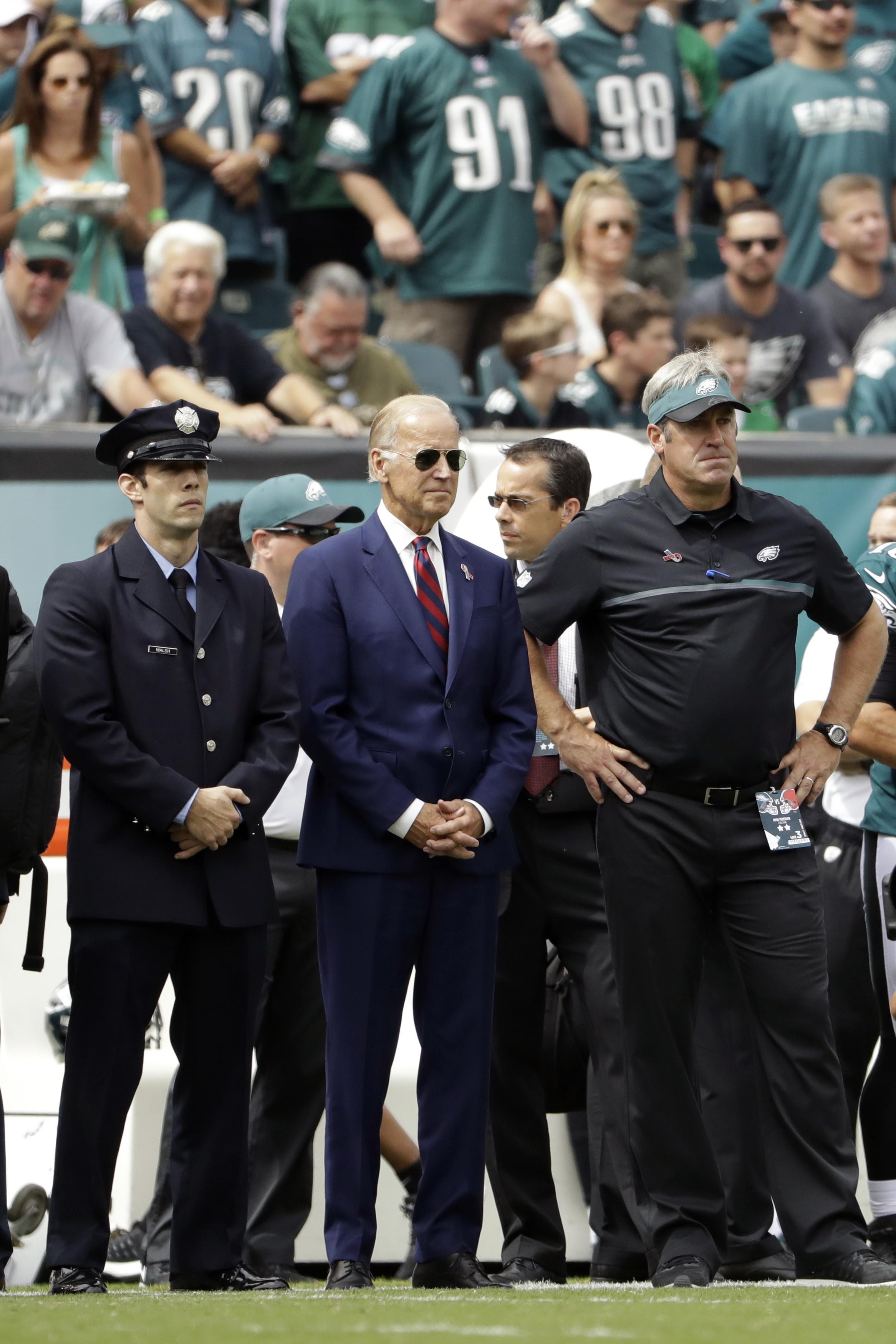 Vice President Joe Biden, center,  and Philadelphia Eagles head coach Doug Pederson, right,  stand before an NFL football game against the Cleveland Browns, Sunday, Sept. 11, 2016, in Philadelphia. (AP Photo/Matt Rourke)
