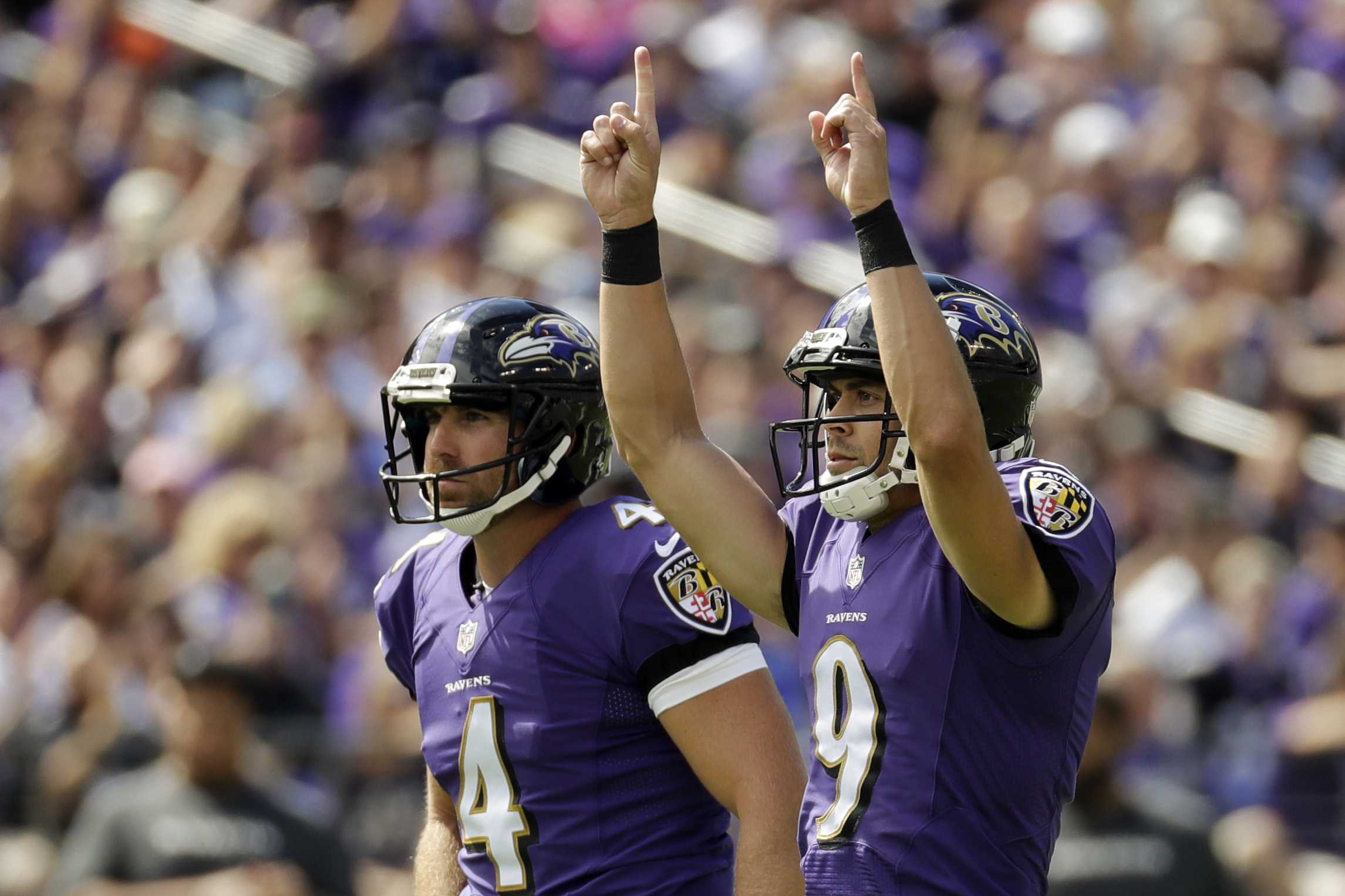 Baltimore Ravens kicker Justin Tucker (9) celebrates his field goal as he walks off the field with teammate Sam Koch (4) during the first half of an NFL football game against the Buffalo Bills in Baltimore, Sunday, Sept. 11, 2016. (AP Photo/Patrick Semans