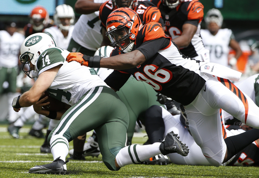 Cincinnati Bengals' Carlos Dunlap (96) tackles New York Jets quarterback Ryan Fitzpatrick (14) during the first half of an NFL football game Sunday, Sept. 11, 2016 in East Rutherford, N.J. (AP Photo/Kathy Willens)