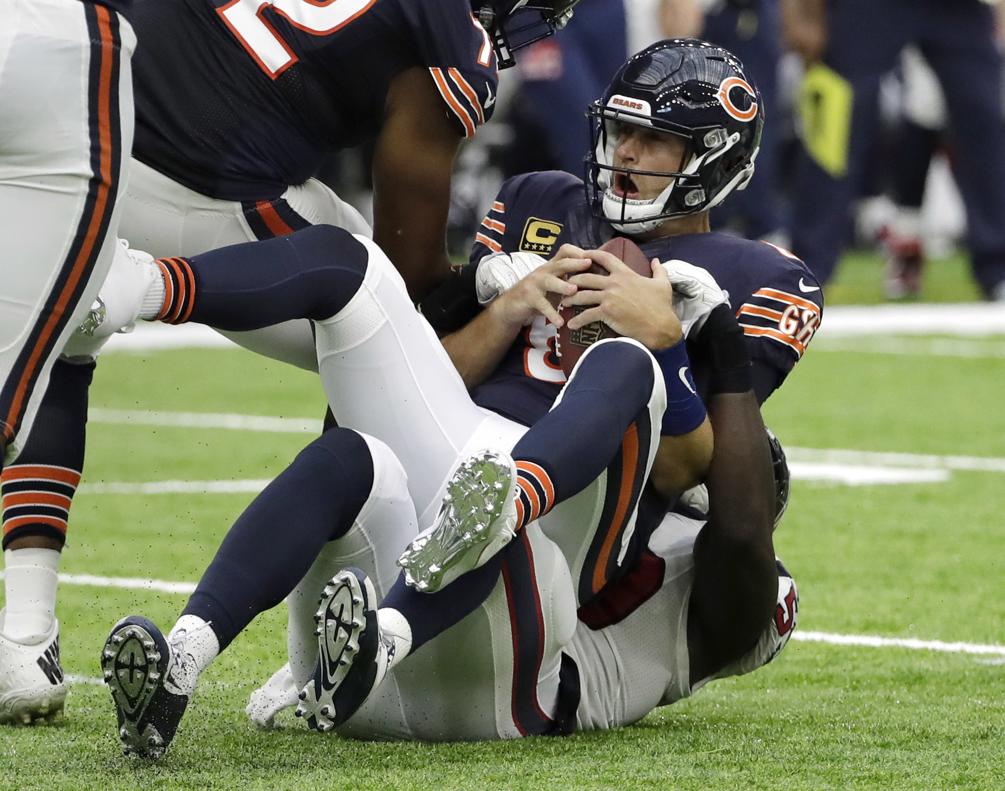 Chicago Bears quarterback Jay Cutler (6) is sacked by Houston Texans outside linebacker Whitney Mercilus, bottom, during the first half of an NFL football game, Sunday, Sept. 11, 2016, in Houston. (AP Photo/David J. Phillip)