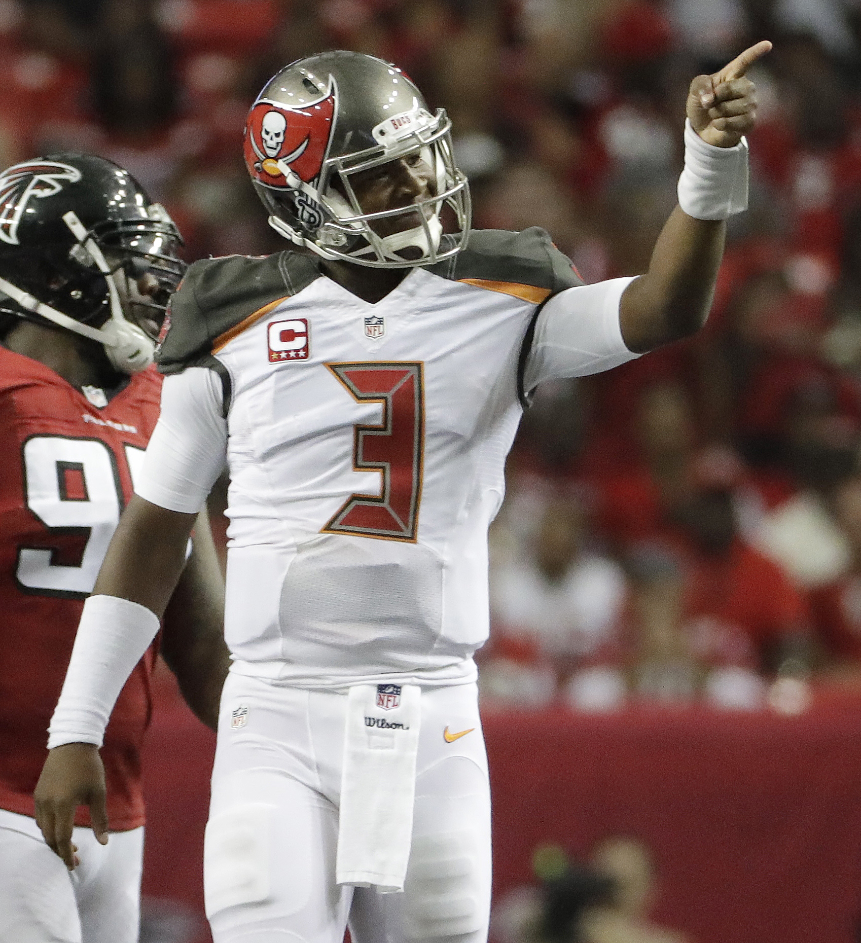 Tampa Bay Buccaneers quarterback Jameis Winston (3) signifies a Tampa Bay Buccaneers first down against the Atlanta Falcons during the first half of an NFL football game, Sunday, Sept. 11, 2016, in Atlanta. (AP Photo/David Goldman)