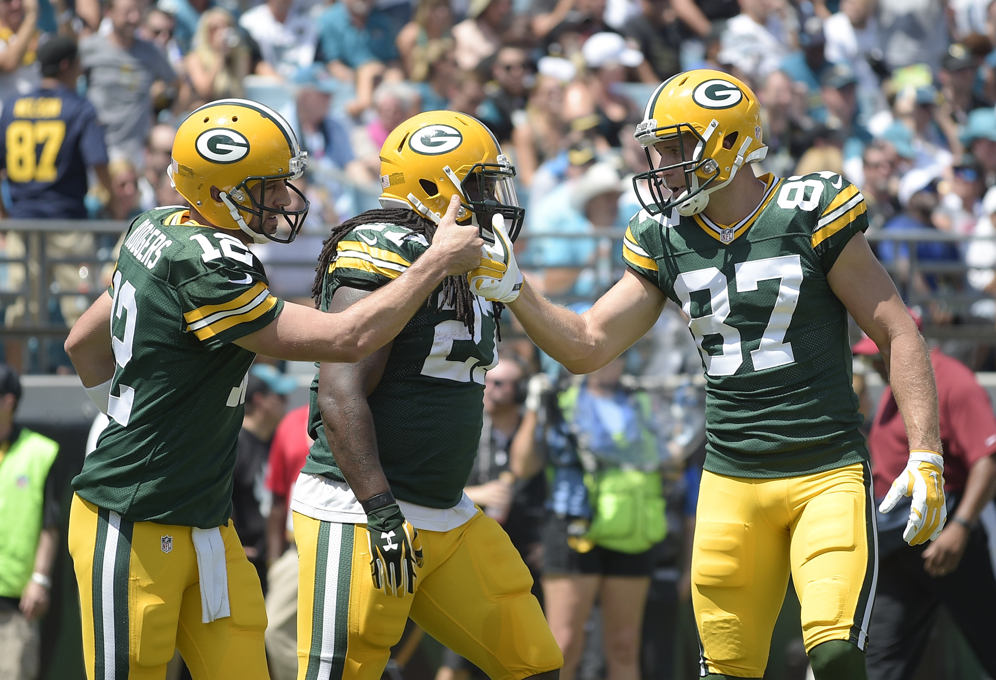 Green Bay Packers quarterback Aaron Rodgers celebrates his touchdown run against the Jacksonville Jaguars with wide receiver Jordy Nelson (87) during the first half of an NFL football game in Jacksonville, Fla., Sunday, Sept. 11, 2016.(AP Photo/Phelan M.