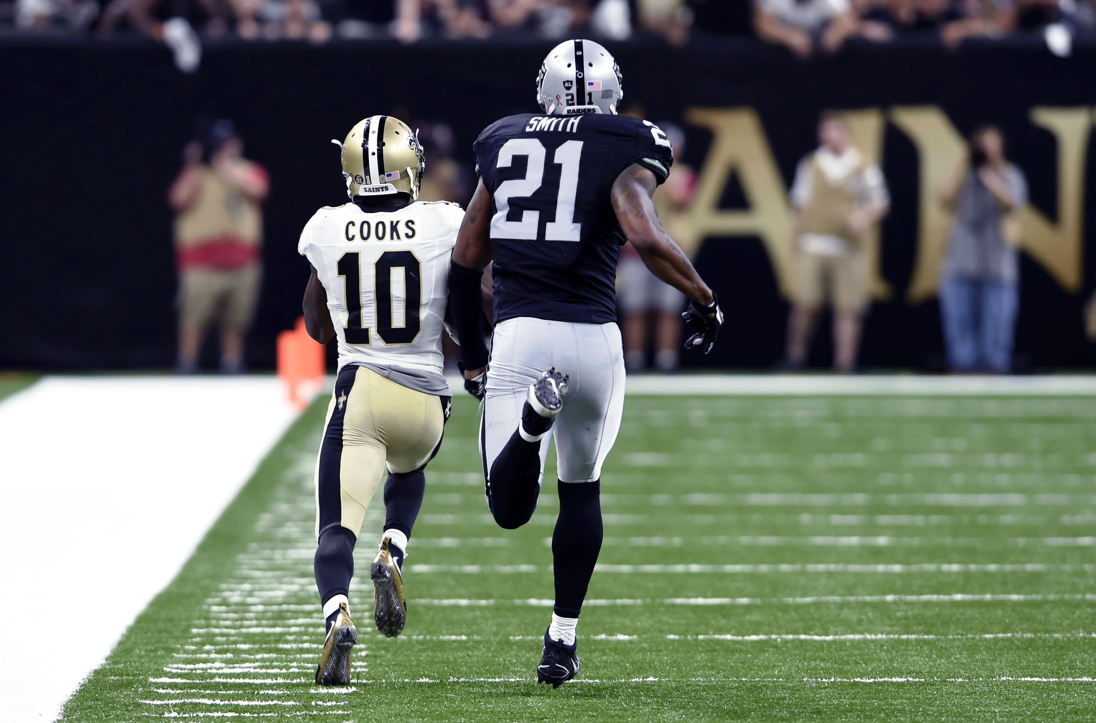New Orleans Saints wide receiver Brandin Cooks (10) pulls in a touchdown reception in front of Oakland Raiders defensive back Sean Smith (21) in the second half of an NFL football game in New Orleans, Sunday, Sept. 11, 2016. The play was longer than any i
