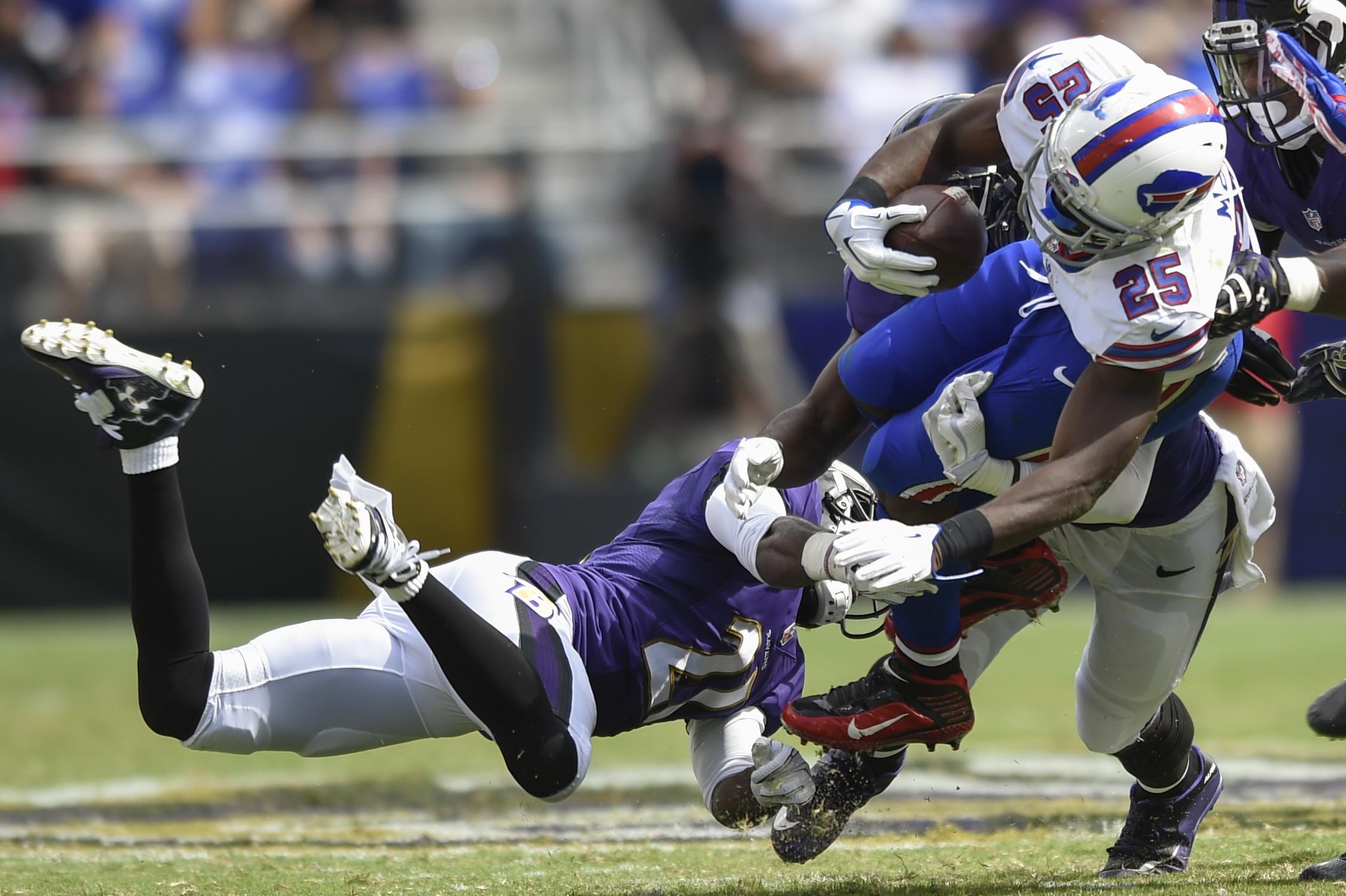 Buffalo Bills running back LeSean McCoy (25) is upended by Baltimore Ravens cornerback Lardarius Webb (21) during the second half of an NFL football game n Baltimore, Sunday, Sept. 11, 2016. (AP Photo/Gail Burton)