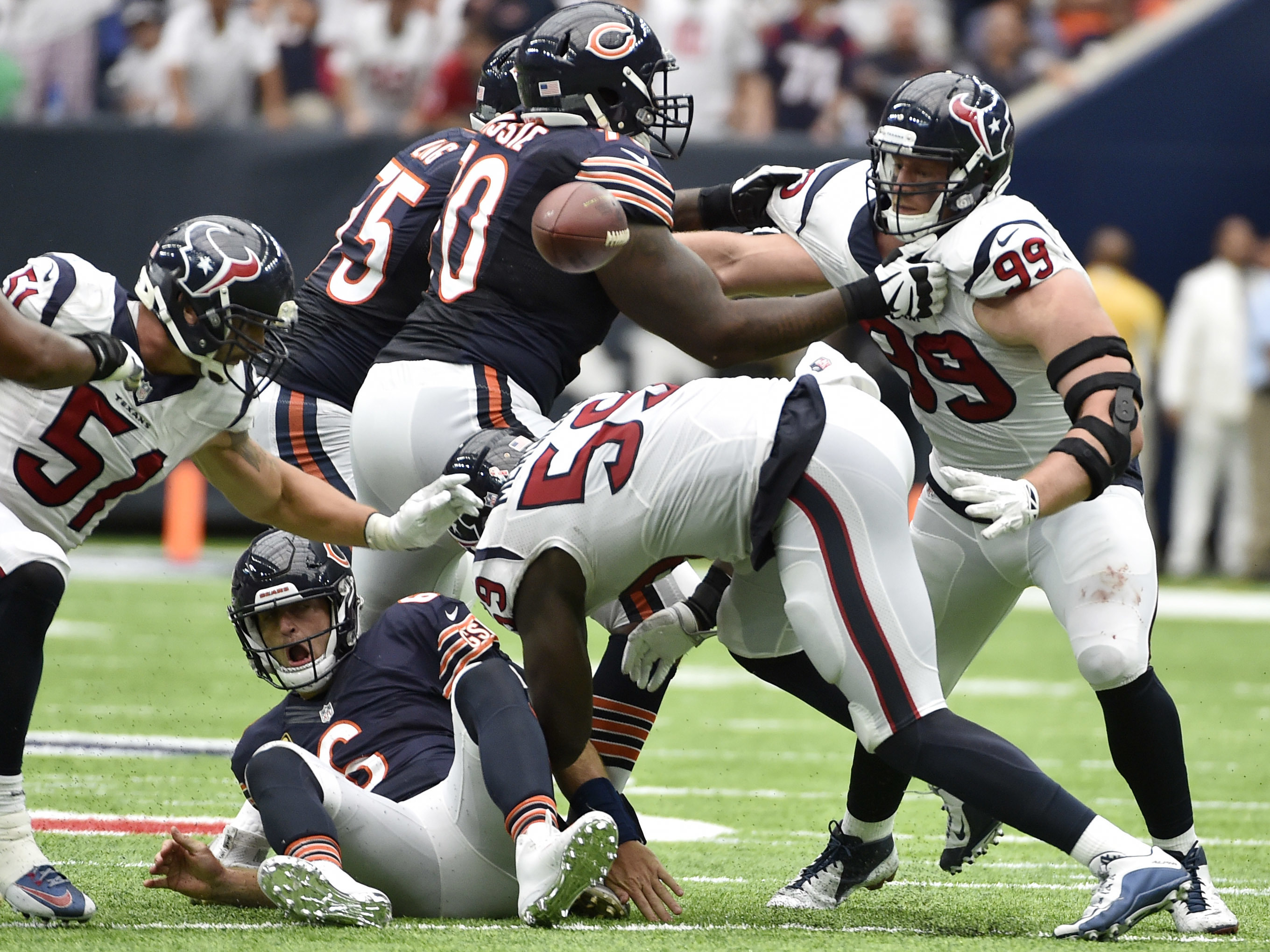 Houston Texans outside linebacker Whitney Mercilus (59) forces Chicago Bears quarterback Jay Cutler, center, to fumble during the second half of an NFL football game Sunday, Sept. 11, 2016, in Houston. Houston Texans defensive end J.J. Watt (99) and outsi