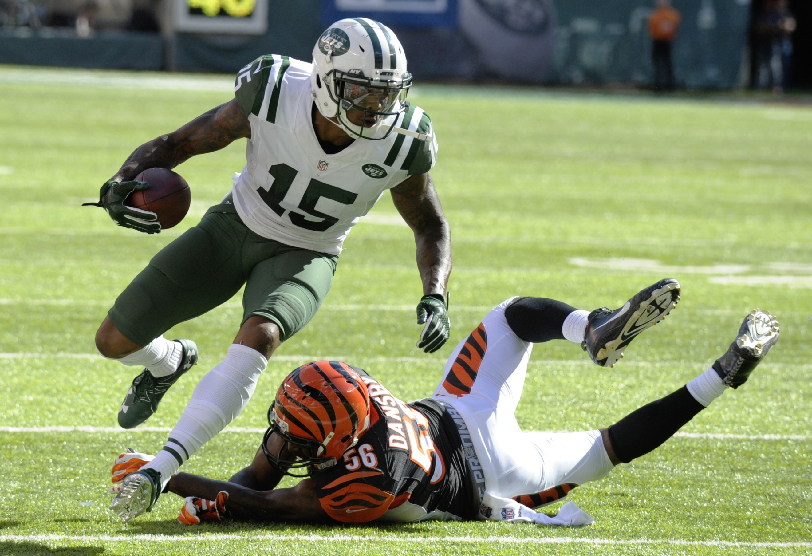 New York Jets wide receiver Brandon Marshall (15) runs past Cincinnati Bengals' Karlos Dansby (56) during the second half of an NFL football game Sunday, Sept. 11, 2016 in East Rutherford, N.J. (AP Photo/Bill Kostroun)