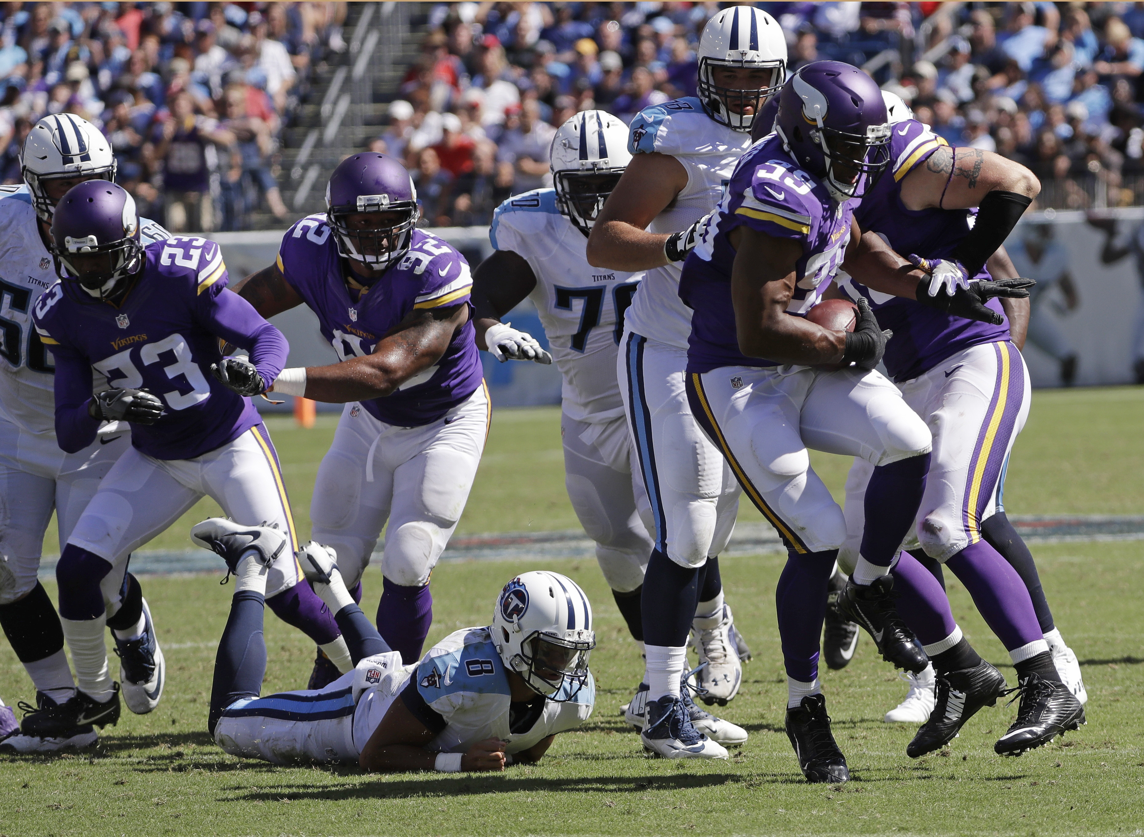 Minnesota Vikings defensive end Danielle Hunter (99) recovers a fumble by Tennessee Titans quarterback Marcus Mariota (8) and runs the ball 24 yards for a touchdown in the second half of an NFL football game Sunday, Sept. 11, 2016, in Nashville, Tenn. (AP
