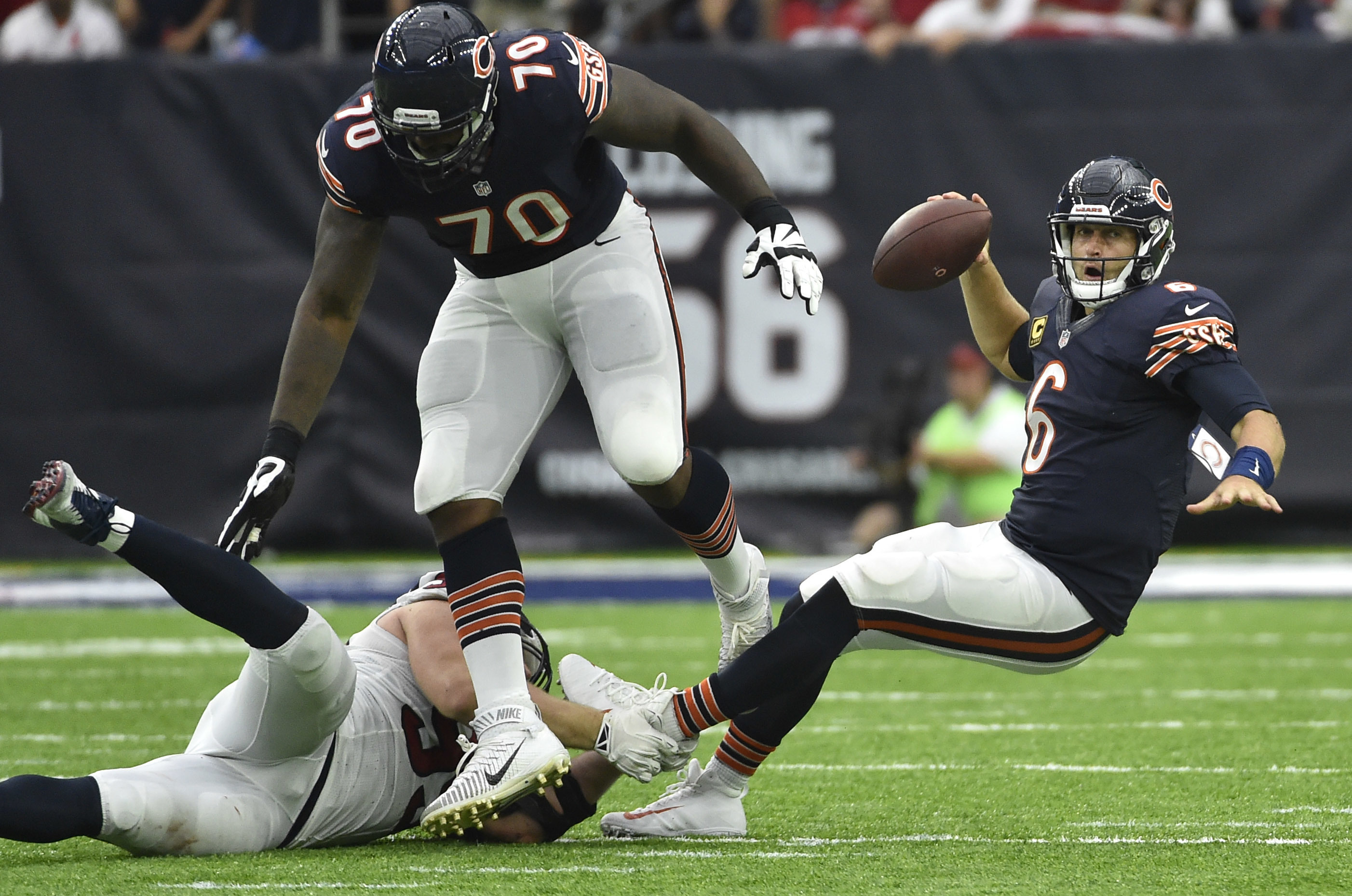 Chicago Bears quarterback Jay Cutler (6) is tripped up by Houston Texans defensive end J.J. Watt, left, during the second half of an NFL football game, Sunday, Sept. 11, 2016, in Houston. Houston won 23-14. (AP Photo/Eric Christian Smith)