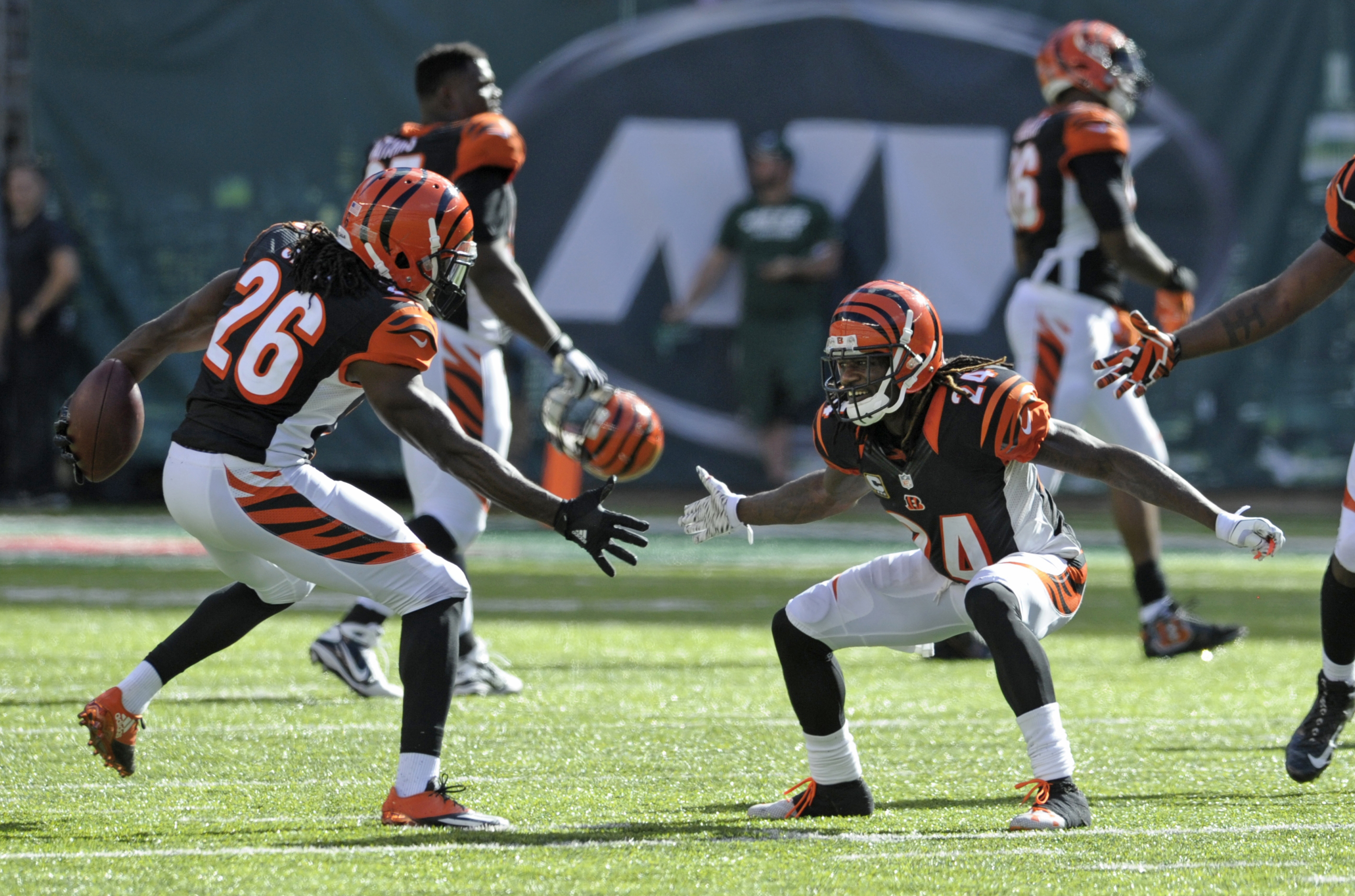 Cincinnati Bengals cornerback Josh Shaw (26) celebrates with teammate Adam Jones (24) after intercepting a pass during the second half of an NFL football game Sunday, Sept. 11, 2016 in East Rutherford, N.J. The Bengals won 23-22. (AP Photo/Bill Kostroun)