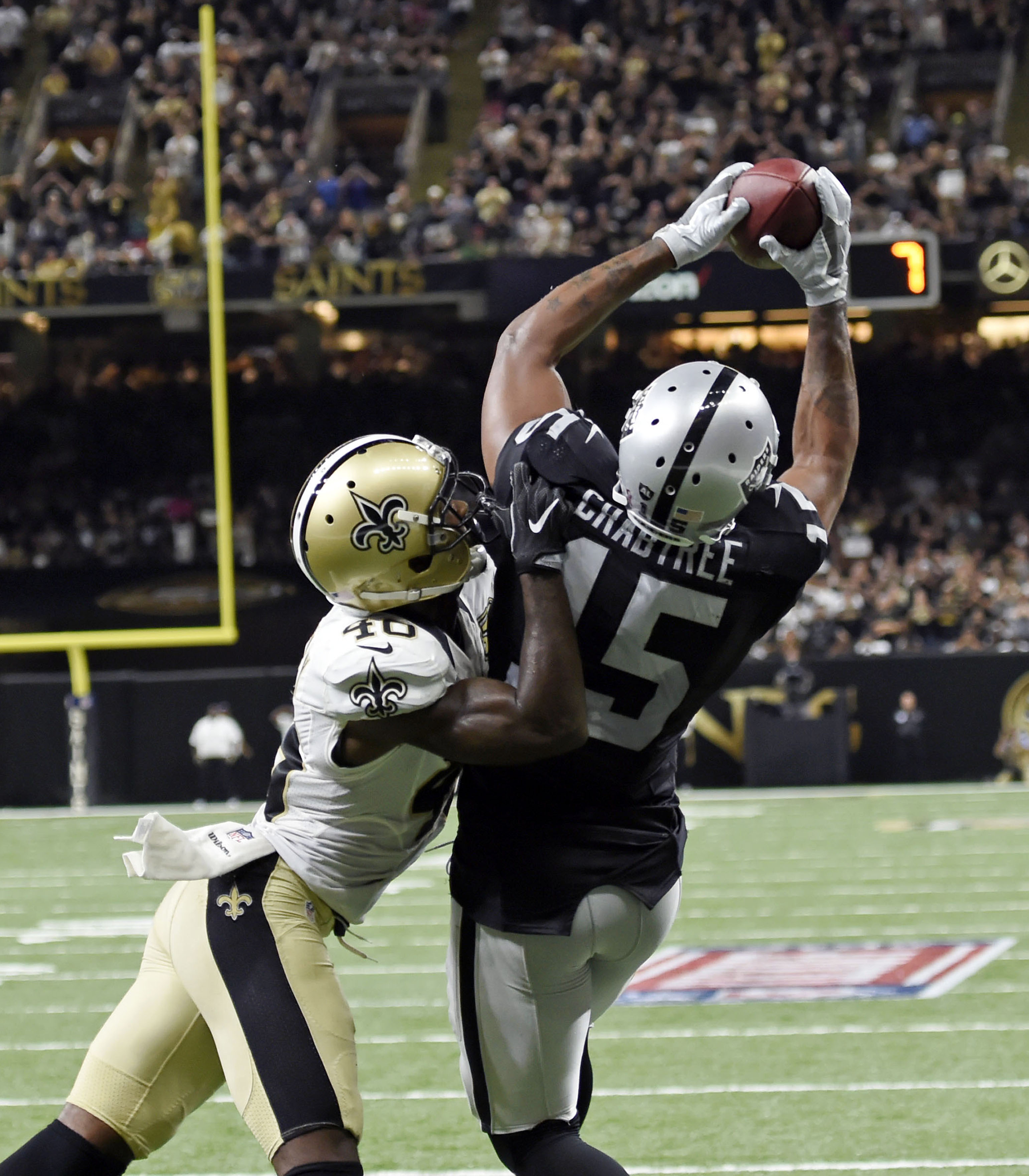 Oakland Raiders wide receiver Michael Crabtree (15) pulls in a touchdown reception over New Orleans Saints cornerback Ken Crawley (46) in the second half of an NFL football game in New Orleans, Sunday, Sept. 11, 2016. (AP Photo/Bill Feig)