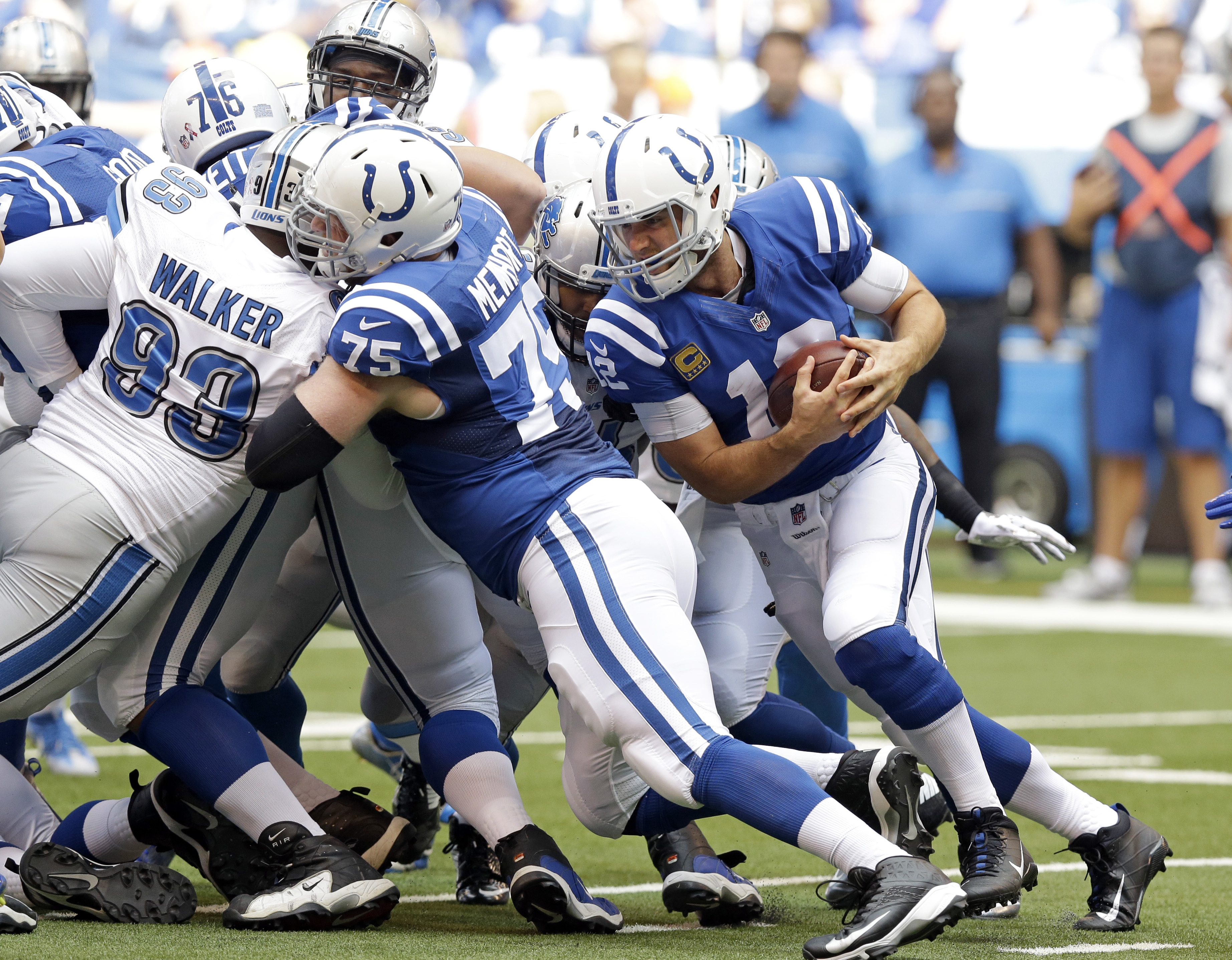Indianapolis Colts quarterback Andrew Luck (12) runs for a first down against the Detroit Lions during the first half of an NFL football game in Indianapolis, Sunday, Sept. 11, 2016. (AP Photo/Michael Conroy)