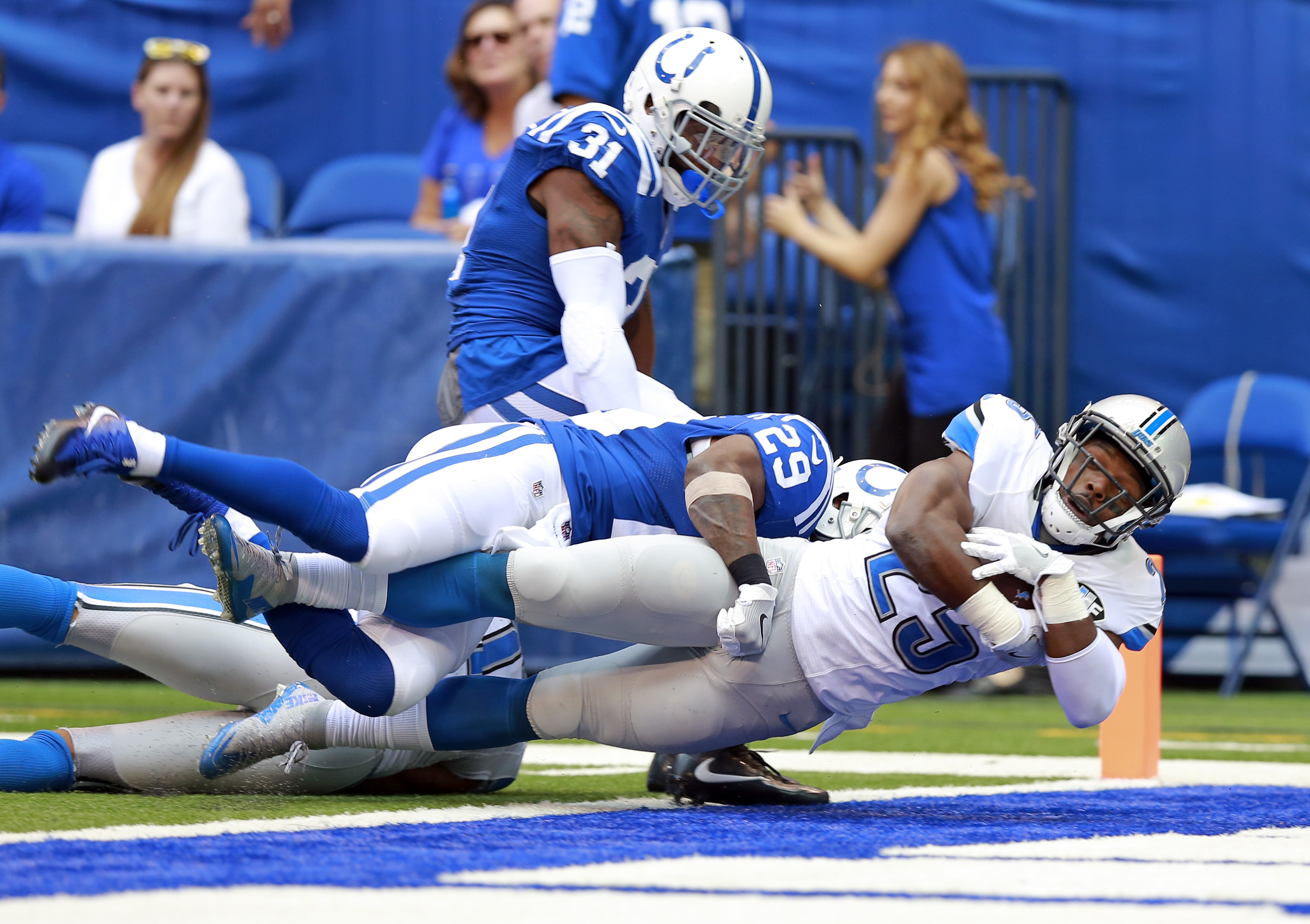 Detroit Lions running back Theo Riddick (25) dives in for a touchdown as he's tackled by Indianapolis Colts strong safety Mike Adams (29) against the Indianapolis Colts during the first half of an NFL football game in Indianapolis, Sunday, Sept. 11, 2016.