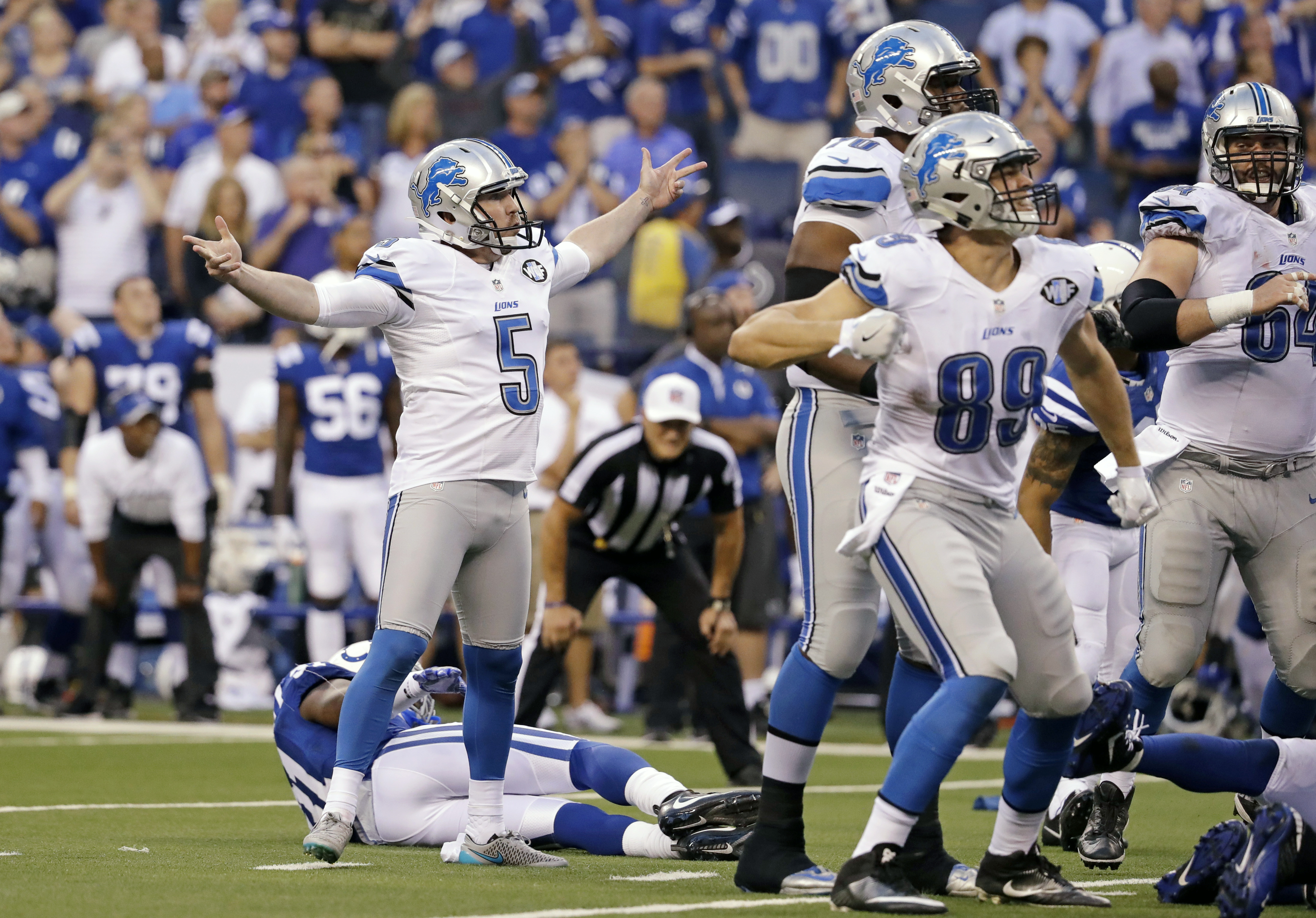 Detroit Lions kicker Matt Prater (5) celebrates a game-winning field goal in the final seconds of the game against the Indianapolis Colts in an NFL football game in Indianapolis, Sunday, Sept. 11, 2016. The Lions defeated the Colts 39-35. (AP Photo/Jeff R