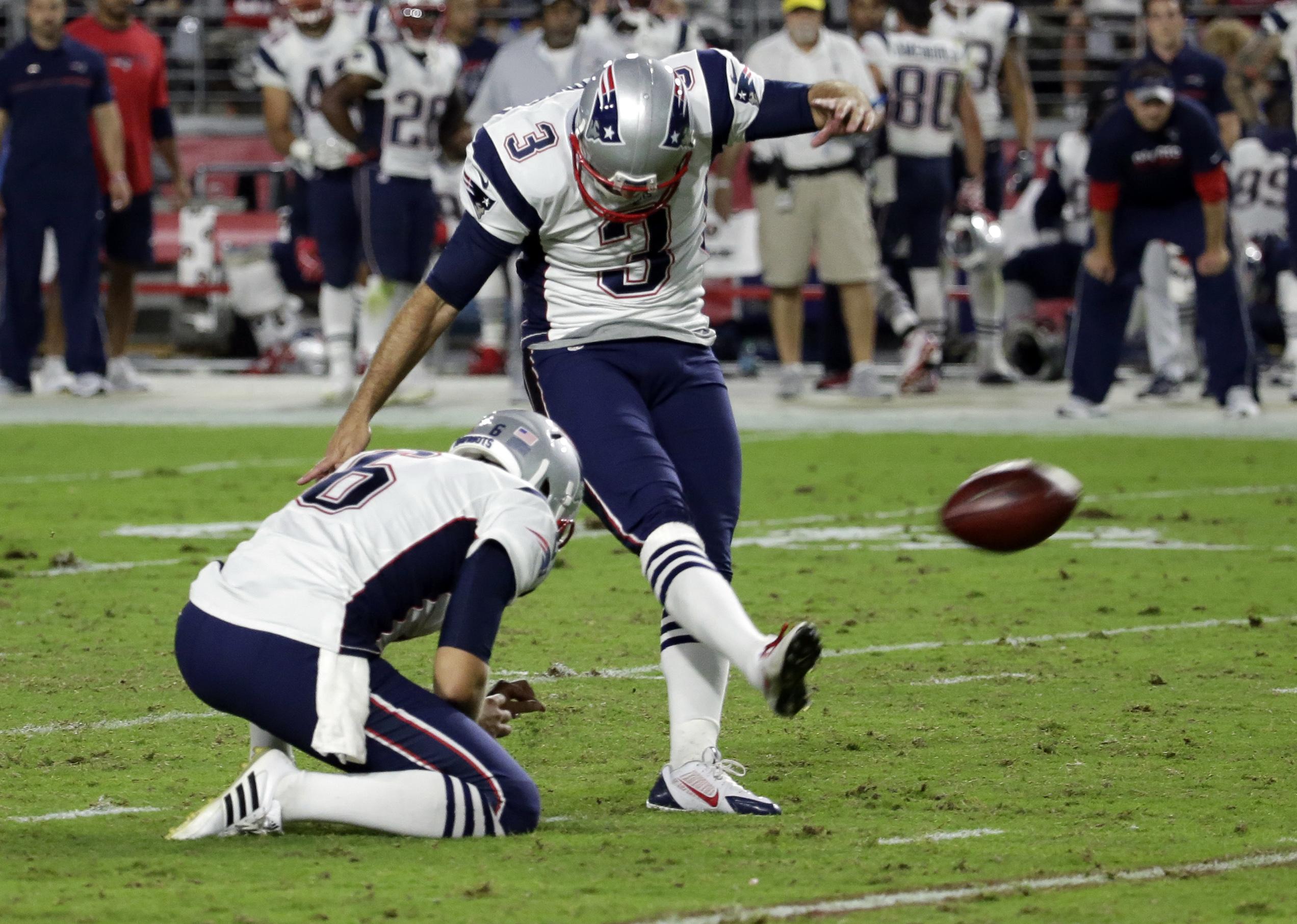 New England Patriots kicker Stephen Gostkowski (3) kicks a field goal as punter Ryan Allen (6) holds during the second half of an NFL football game against the Arizona Cardinals, Sunday, Sept. 11, 2016, in Glendale, Ariz. (AP Photo/Rick Scuteri)
