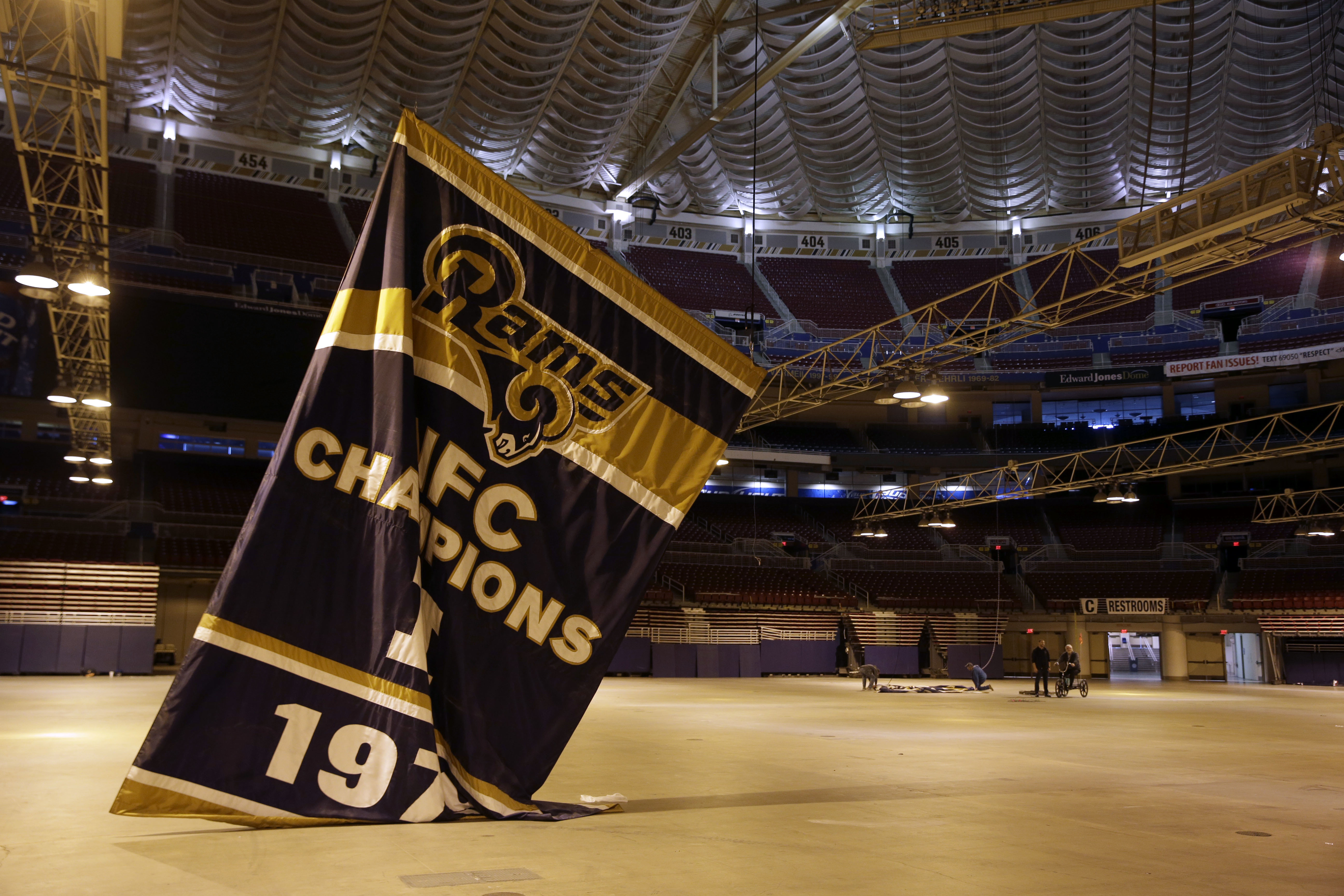 FILE - In this Jan. 14, 2016 file photo, championship banners are removed from the Edward Jones Dome, former home of the St. Louis Rams football team in St. Louis. The start of a new NFL season is bringing no buzz of excitement in St. Louis, left without