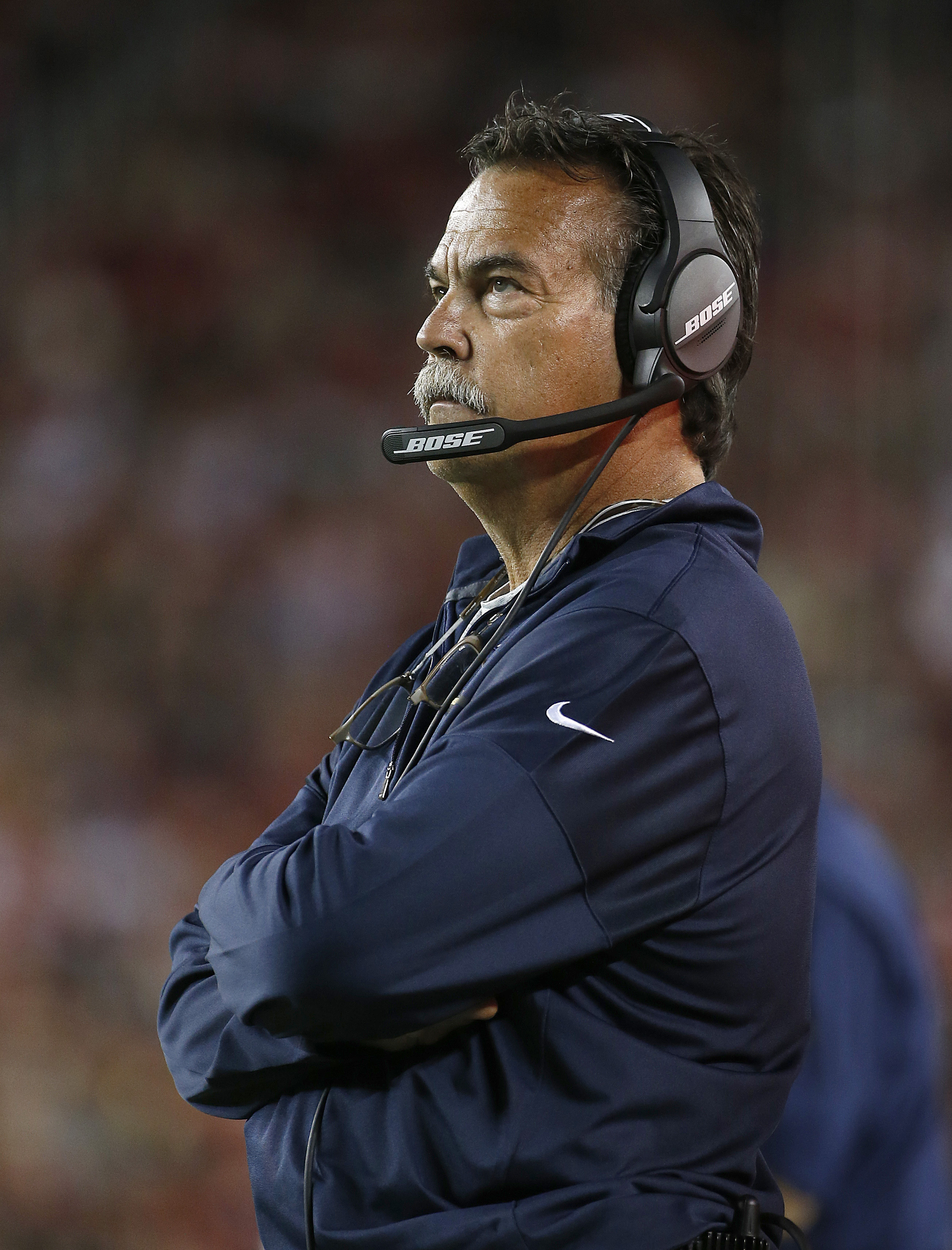Los Angeles Rams head coach Jeff Fisher watches during the second half of an NFL football game against the San Francisco 49ers in Santa Clara, Calif., Monday, Sept. 12, 2016. (AP Photo/Tony Avelar)