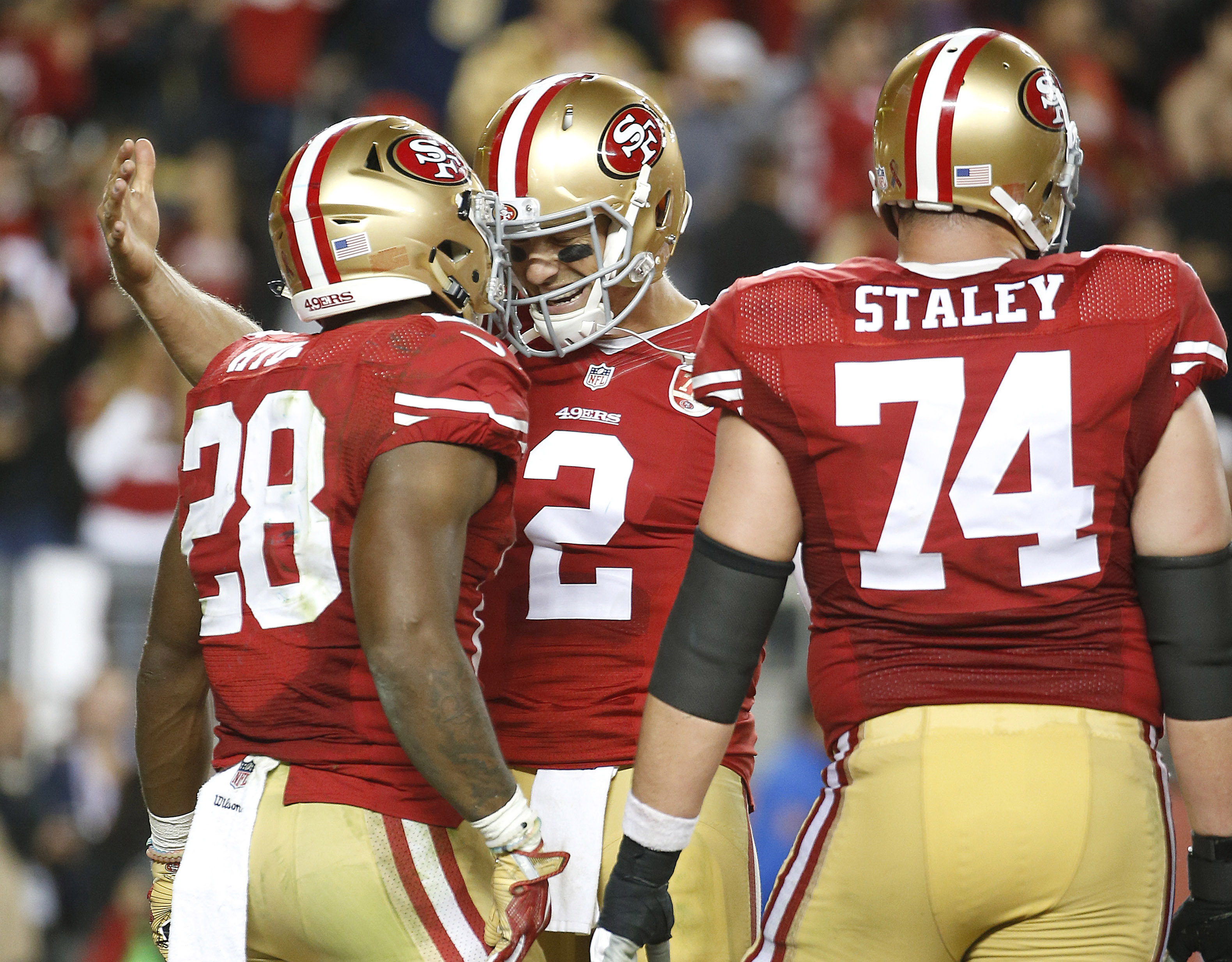 San Francisco 49ers running back Carlos Hyde (28) celebrates after running for a touchdown with quarterback Blaine Gabbert (2) and offensive tackle Joe Staley (74) during the second half of an NFL football game against the Los Angeles Rams in Santa Clara,
