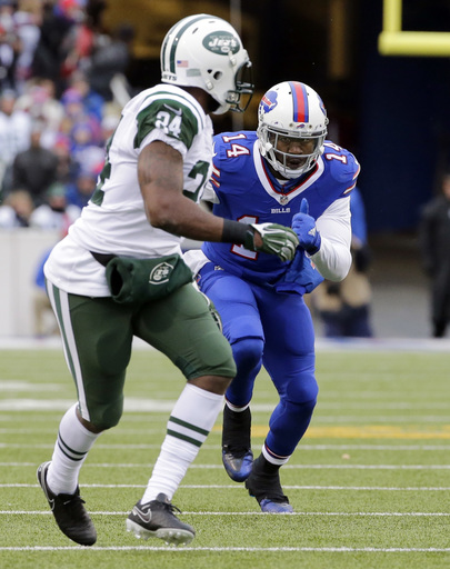 FILE - In this Jan. 3, 2016, file photo, New York Jets cornerback Darrelle Revis (24) defends against Buffalo Bills' Sammy Watkins (14) during the first half of an NFL football game in Orchard Park, N.Y. The Jets are heading to Orchard Park for an AFC Eas