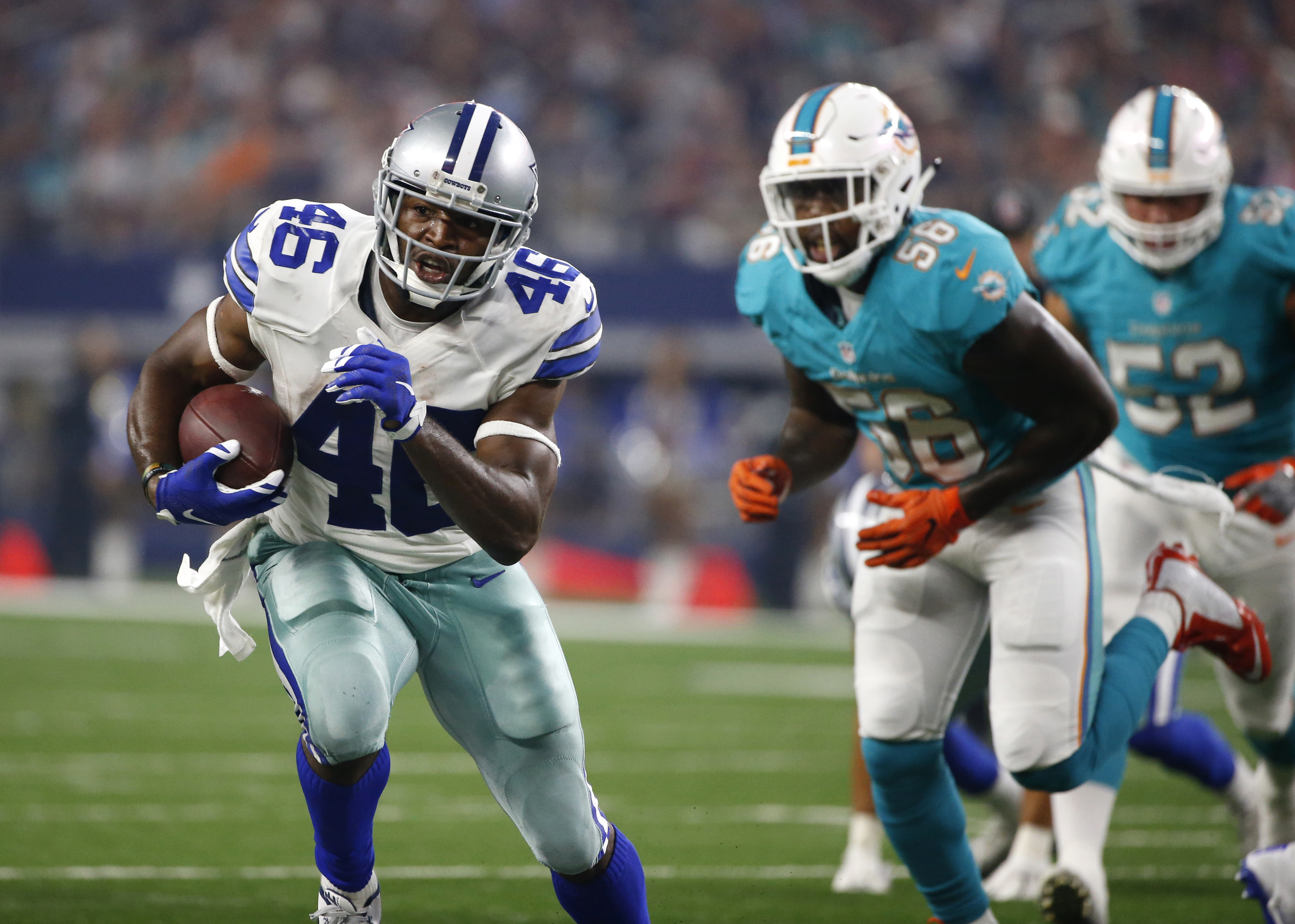 FILE - In this Aug. 19, 2016, file photo, Dallas Cowboys running back Alfred Morris (46) finds running room as Miami Dolphins linebacker James-Michael Johnson (56) gives chase during a preseason NFL football game in Arlington, Texas. Morris wont be trying