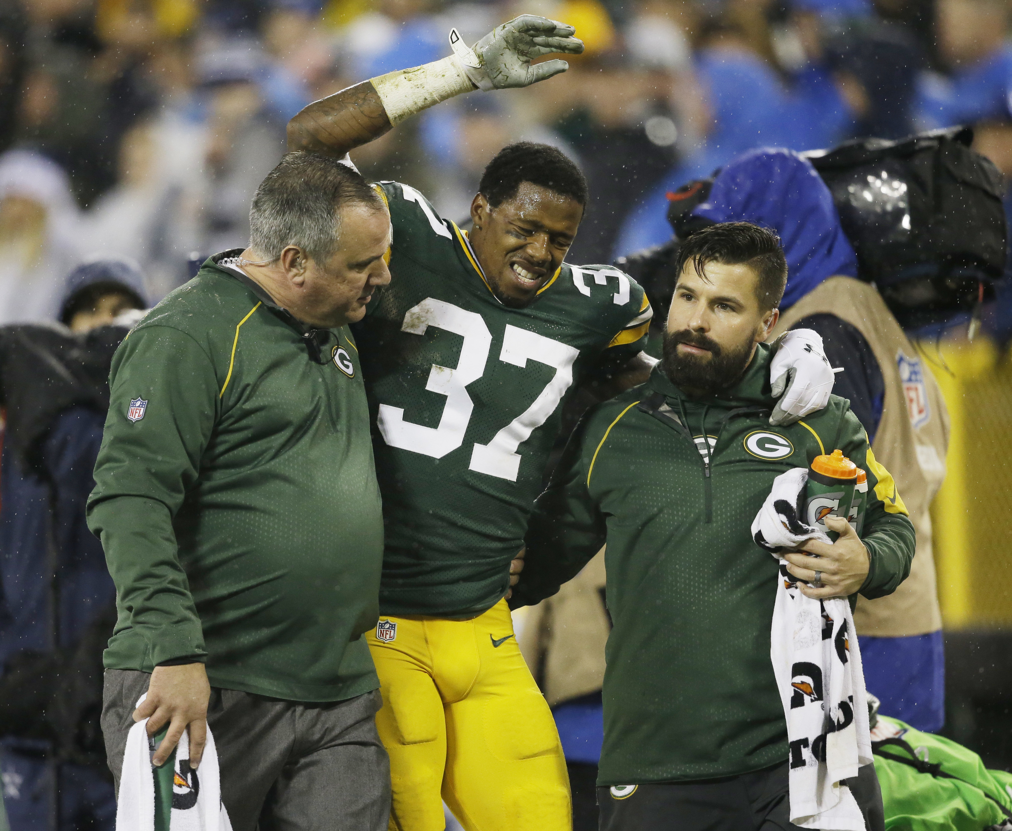 FILE - In this Dec. 13, 2015, file photo, Green Bay Packers' Sam Shields is helped off the field during the first half of an NFL football game against the Dallas Cowboys, in Green Bay, Wis. The Packers roster is running short on healthy cornerbacks going