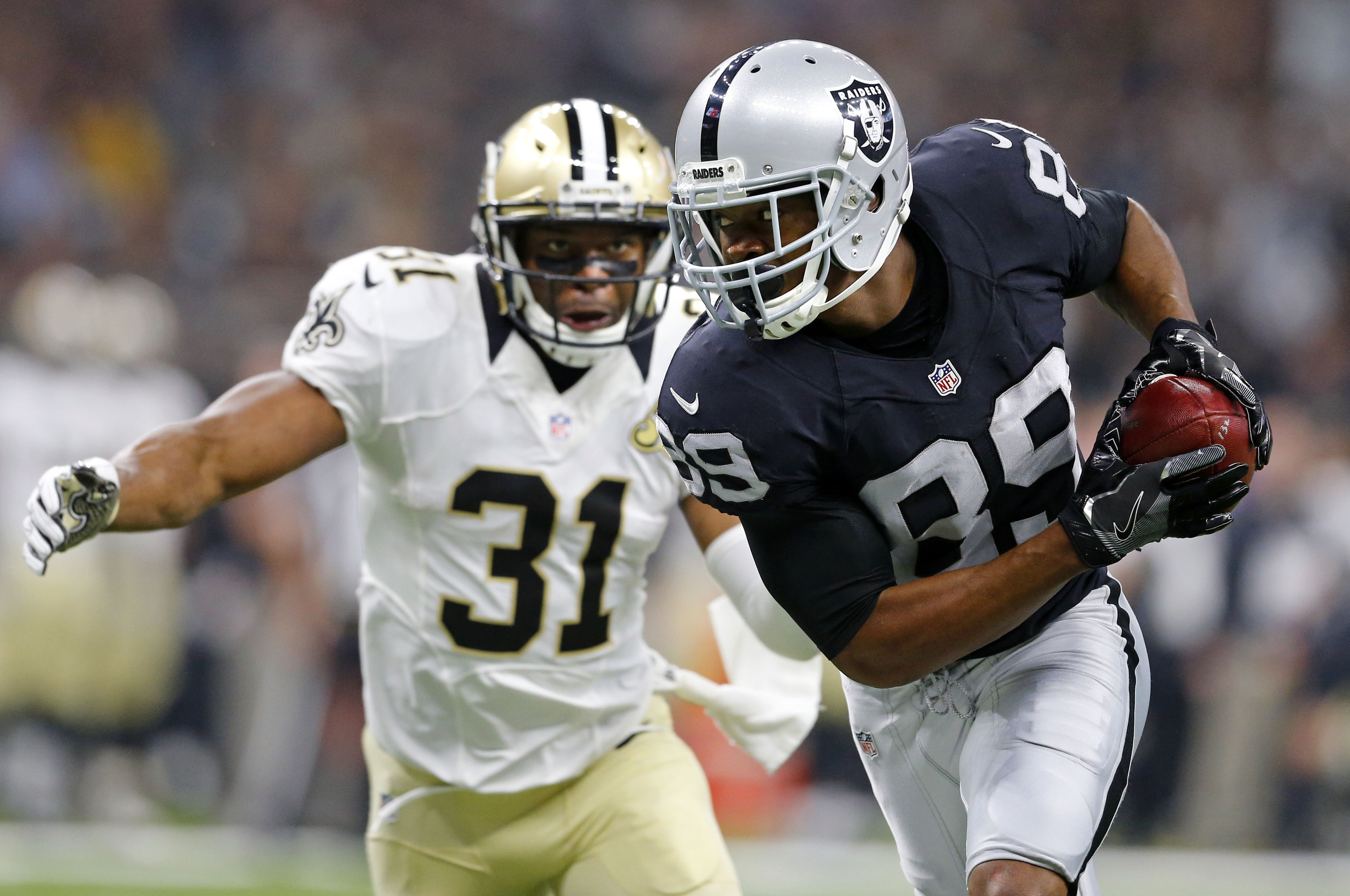 FILE - In this Sunday, Sept. 11, 2016, file photo, Oakland Raiders wide receiver Amari Cooper (89) pulls in a pass reception in front of New Orleans Saints free safety Jairus Byrd (31) in the first half of an NFL football game in New Orleans. When Amari C