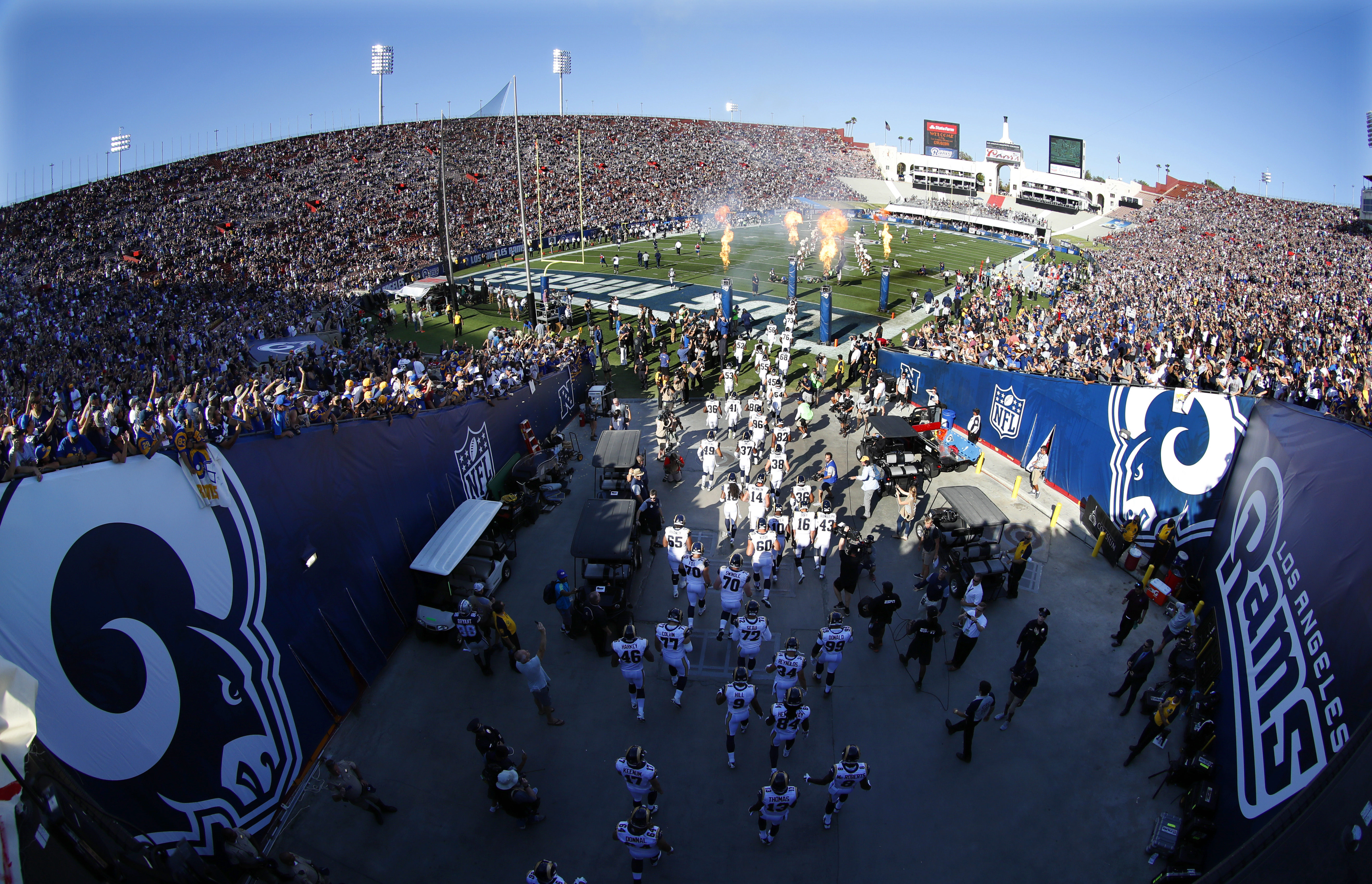 FILE - In this Aug. 13, 2016, file photo, The Los Angeles Rams take the field at Los Angeles Memorial Coliseum for a preseason NFL football game against the Dallas Cowboys in Los Angeles. The nations second-largest city has waited nearly 22 years for Sund