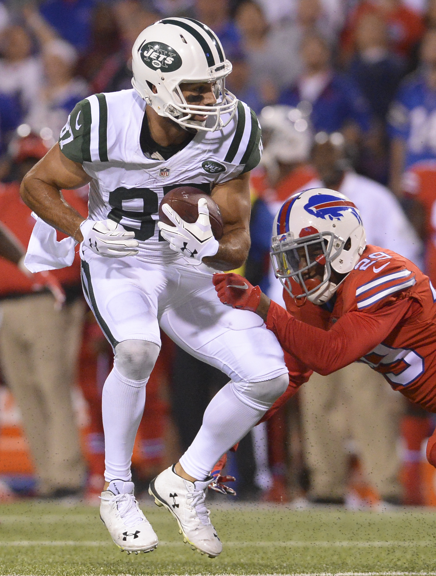 New York Jets wide receiver Eric Decker (87) is hit by Buffalo Bills defender Kevon Seymour (29) during the second half of an NFL football game Thursday, Sept. 15, 2016, in Orchard Park, N.Y. (AP Photo/Adrian Kraus)