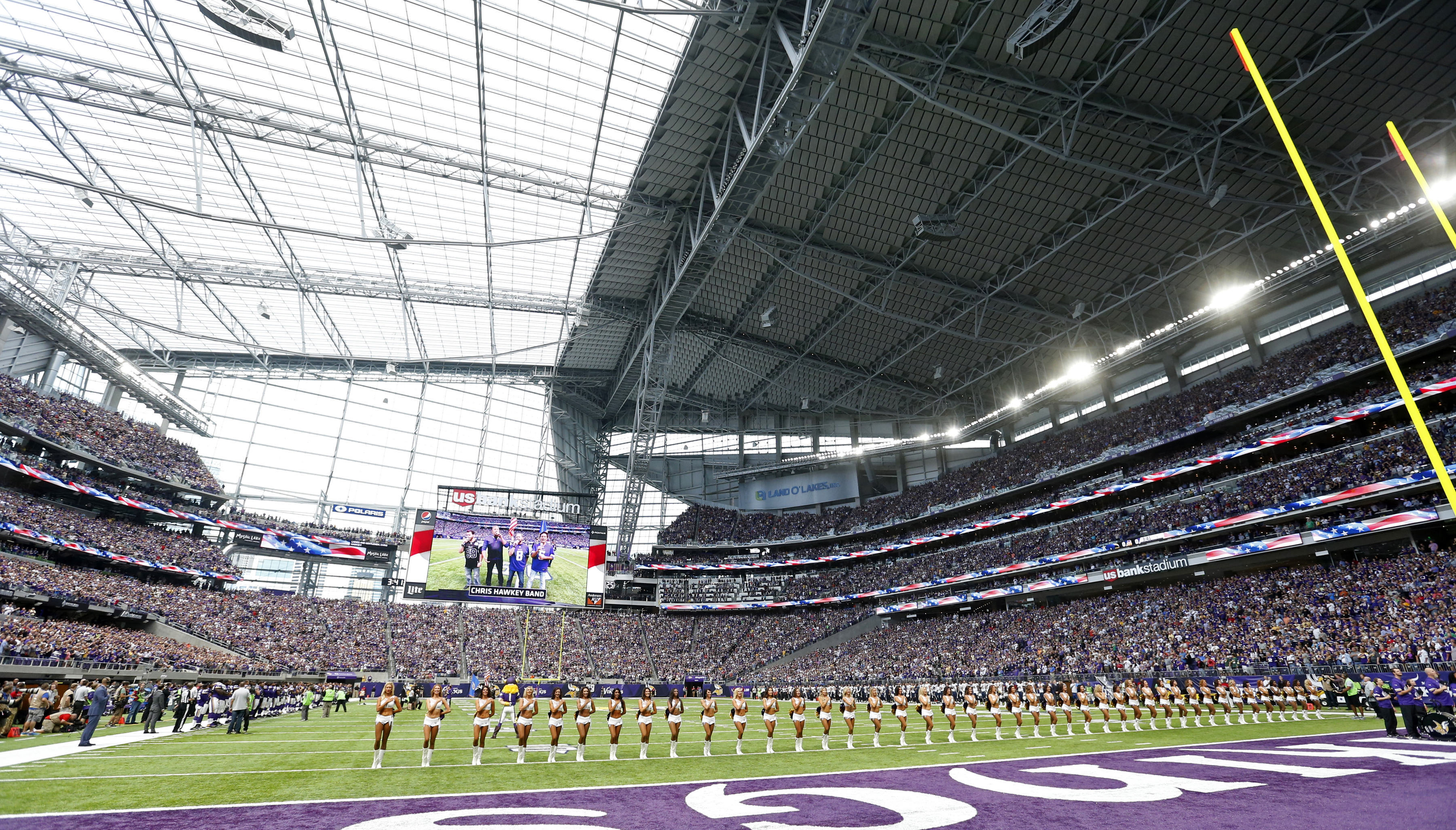 FILE - In this Aug. 28, 2016 file photo, Minnesota Vikings cheerleaders line up on the field before an NFL preseason football game against the San Diego Chargers in Minneapolis. The Vikings will host the Green Bay Packers in the first regular season game