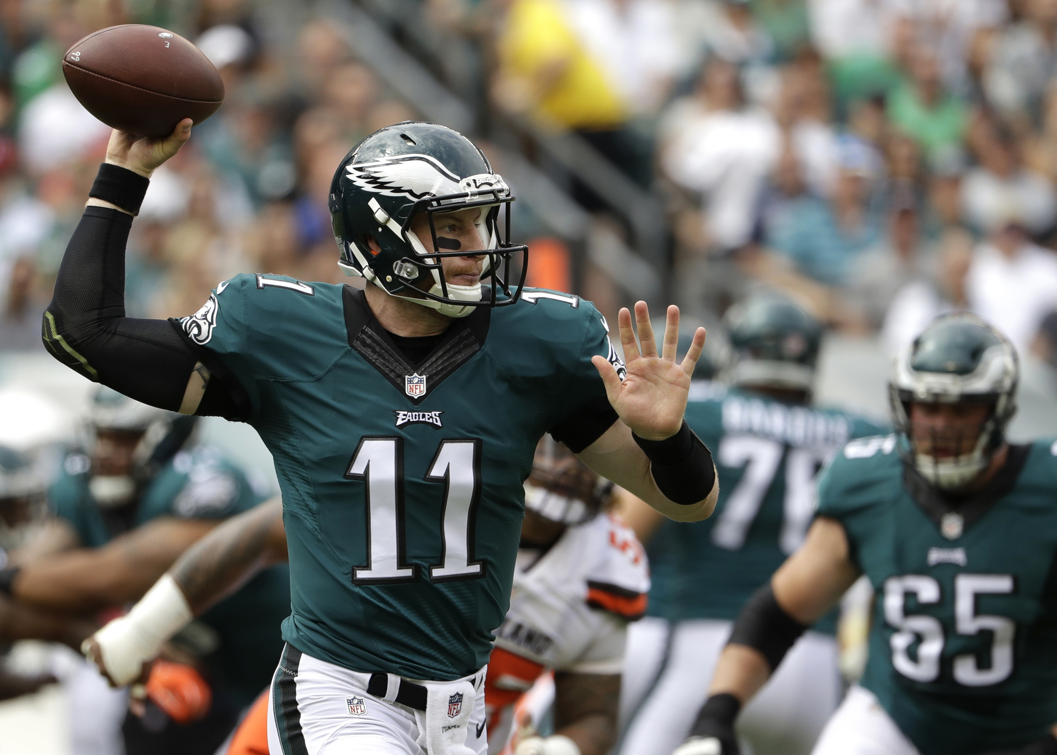 FILE - In this Sunday, Sept. 11, 2016, file photo, Philadelphia Eagles quarterback Carson Wentz passes during an NFL football game against the Cleveland Browns in Philadelphia. The No. 2 overall draft pick, Wentz will try to build on an impressive debut w