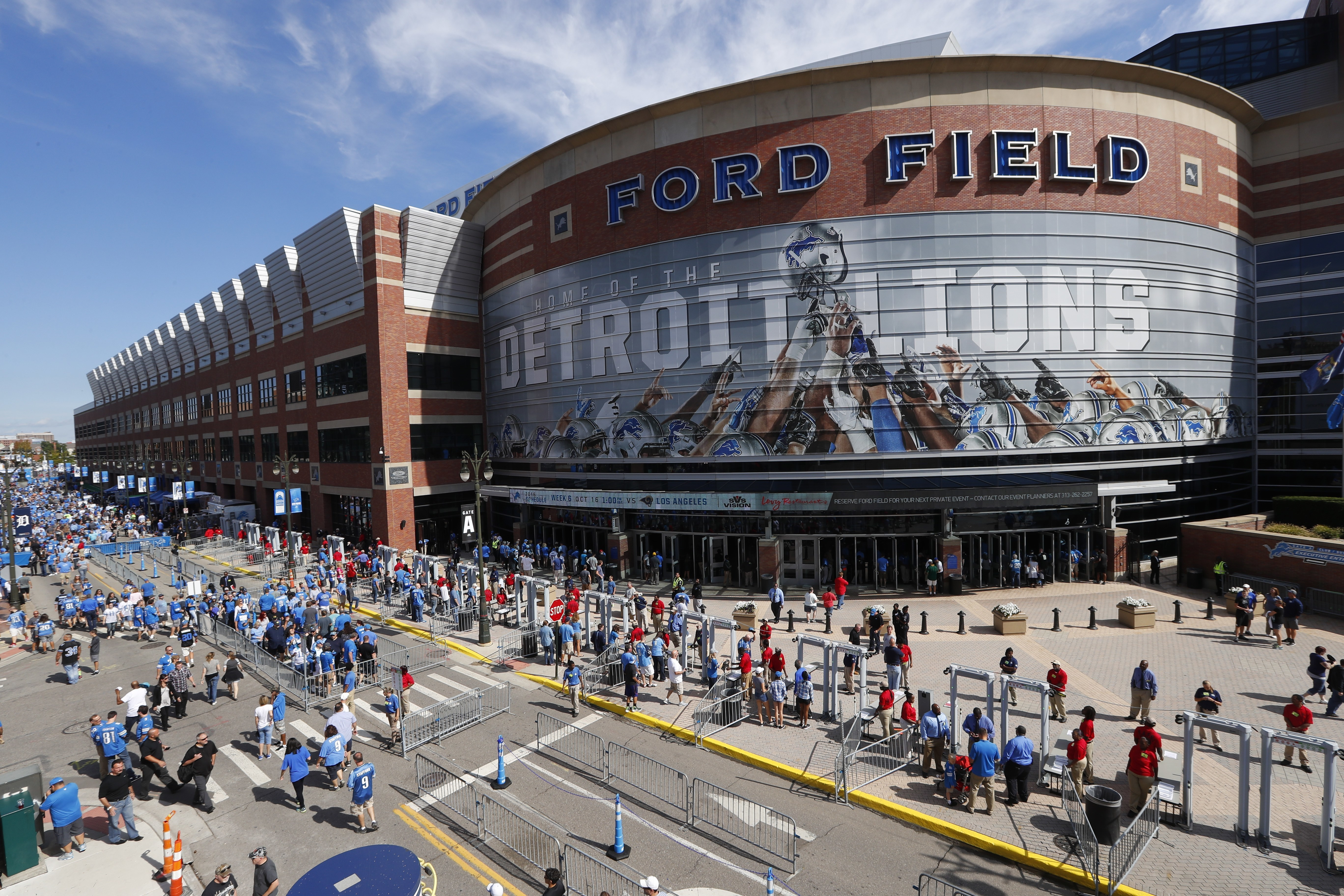 Football fans arrive at Ford Field for an NFL football game between the Detroit Lions and the Tennessee Titans, Sunday, Sept. 18, 2016, in Detroit. (AP Photo/Paul Sancya)