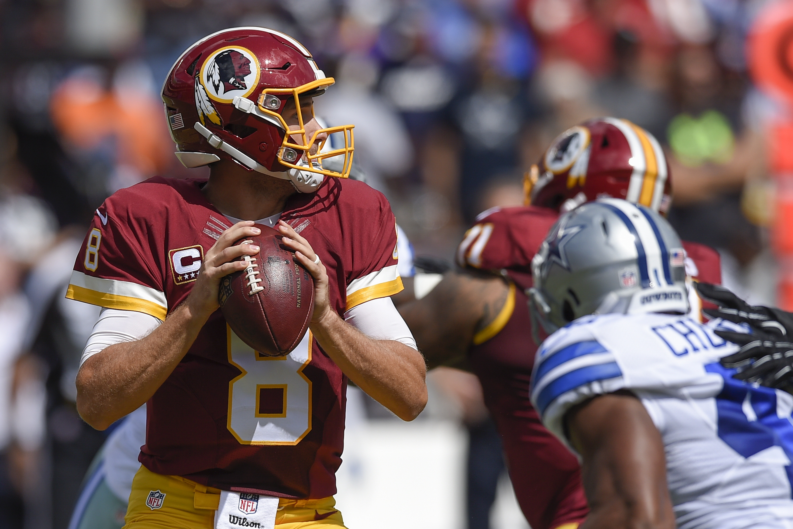 Washington Redskins quarterback Kirk Cousins (8) looks for and open man during the first half of an NFL football game against the Dallas Cowboys in Landover, Md., Sunday, Sept. 18, 2016. (AP Photo/Nick Wass)