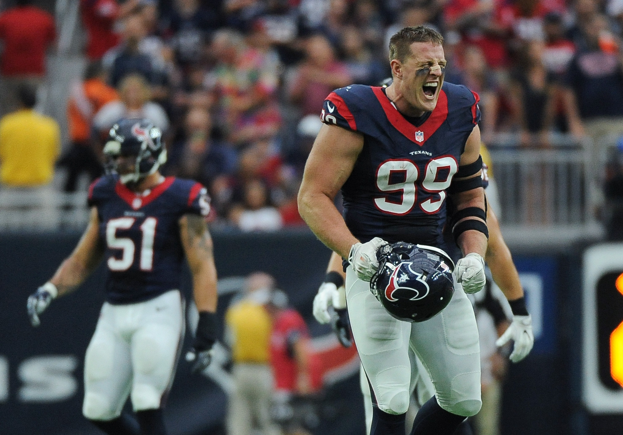 Houston Texans defensive end J.J. Watt (99) celebrates after he sacked Kansas City Chiefs quarterback Alex Smith during the first half of an NFL football game Sunday, Sept. 18, 2016, in Houston. (AP Photo/George Bridges)