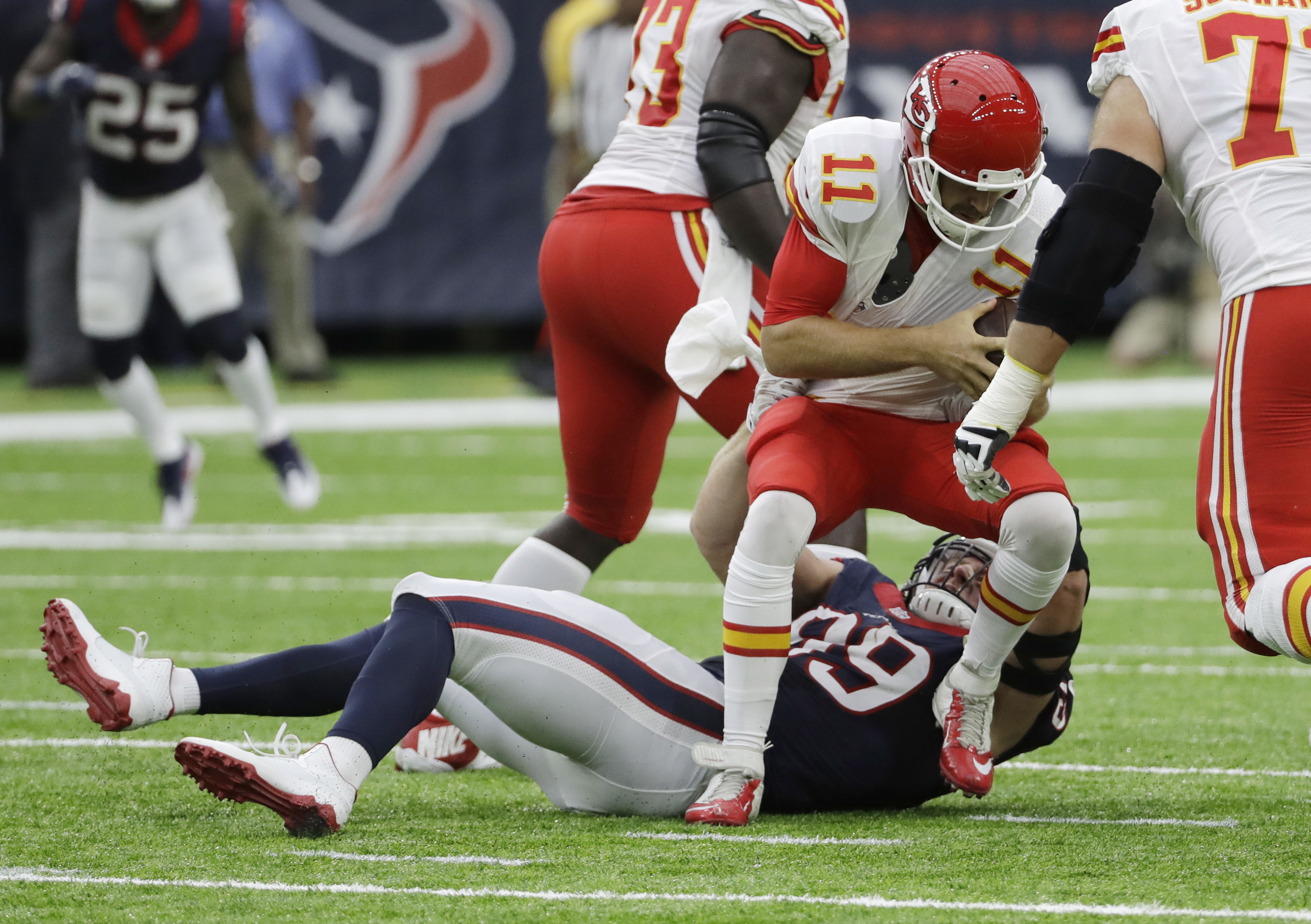 Kansas City Chiefs quarterback Alex Smith (11) is sacked by Houston Texans defensive end J.J. Watt (99) during the first half of an NFL football game Sunday, Sept. 18, 2016, in Houston. (AP Photo/David J. Phillip)