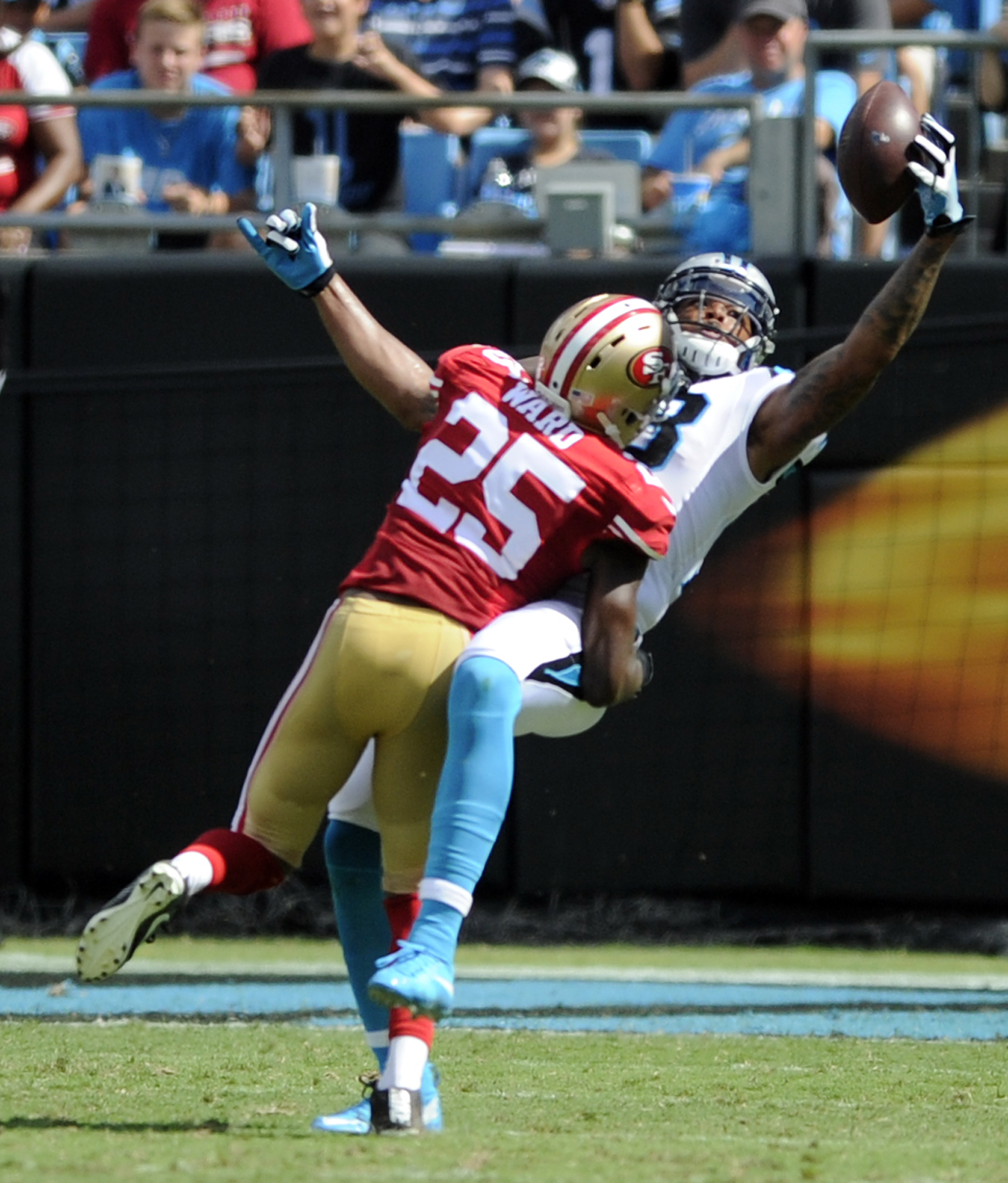 Carolina Panthers' Kelvin Benjamin, back, catches a pass as San Francisco 49ers' Jimmie Ward, front, defends in the second half of an NFL football game in Charlotte, N.C., Sunday, Sept. 18, 2016. (AP Photo/Mike McCarn)