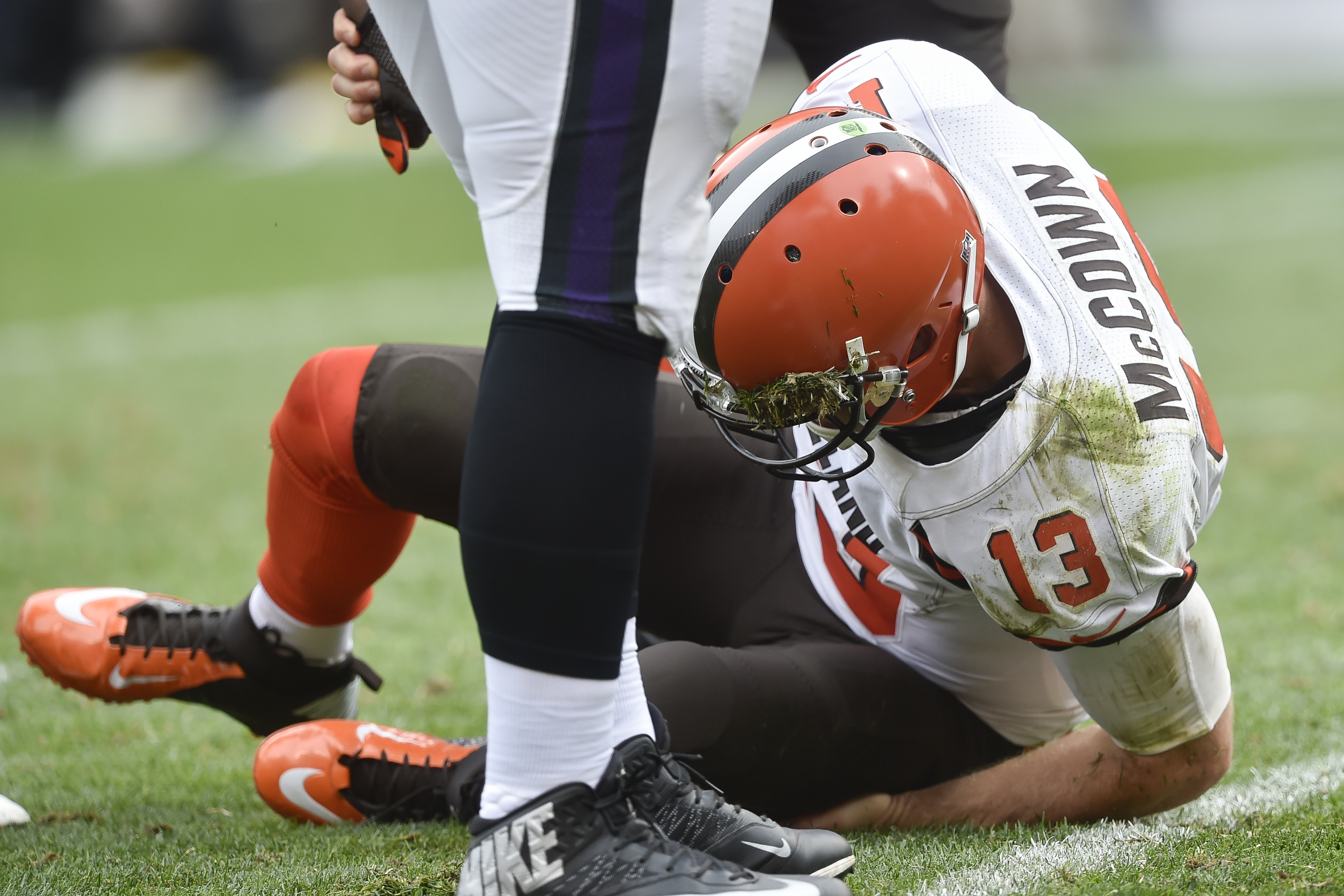 Cleveland Browns quarterback Josh McCown (13) struggles to his feet after taking a hit from Baltimore Ravens inside linebacker C.J. Mosley in the second half of an NFL football game, Sunday, Sept. 18, 2016, in Cleveland. (AP Photo/David Richard)