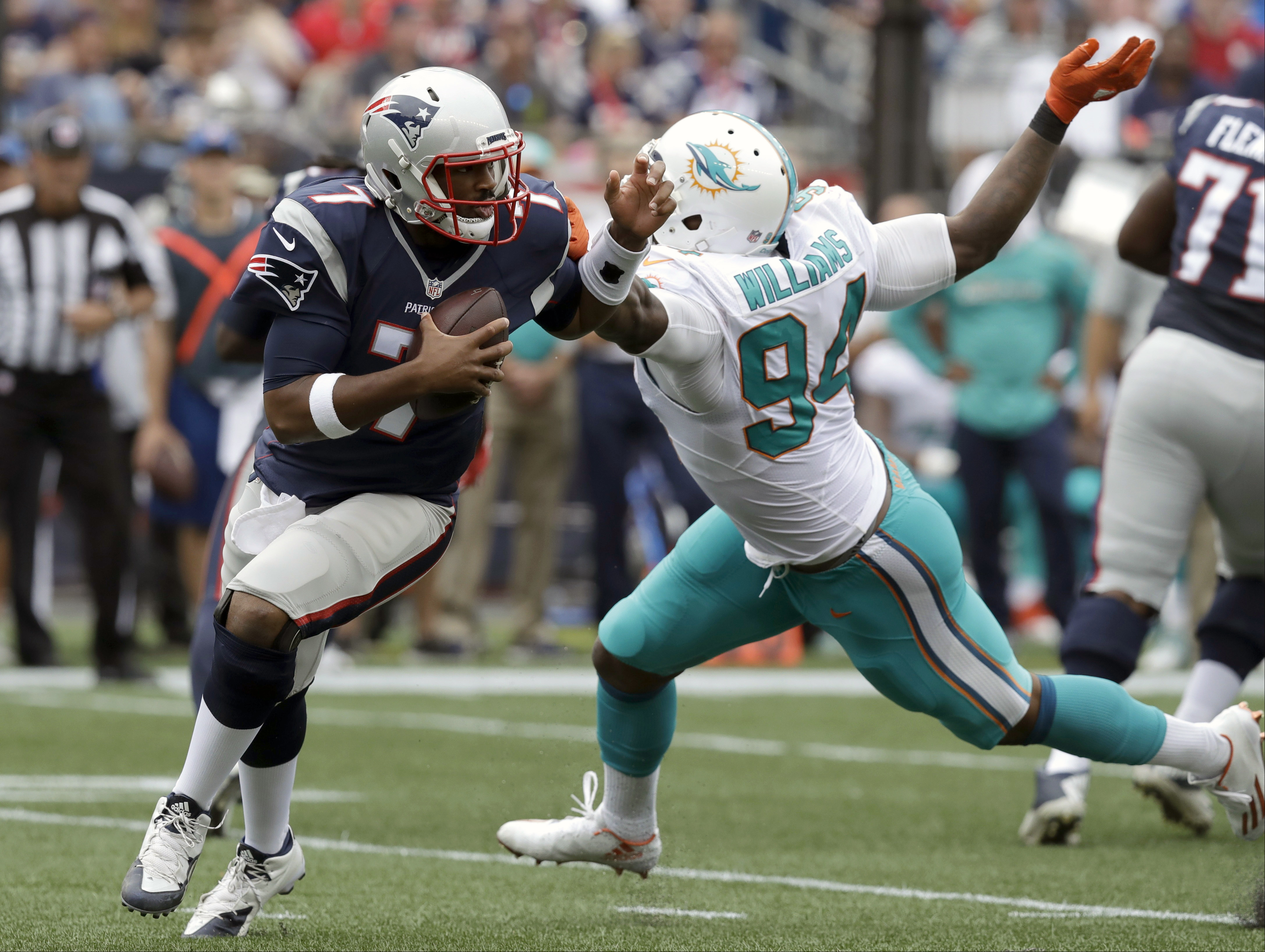 New England Patriots quarterback Jacoby Brissett (7) scrambles away from Miami Dolphins defensive end Mario Williams (94) during the second half of an NFL football game Sunday, Sept. 18, 2016, in Foxborough, Mass. (AP Photo/Charles Krupa)