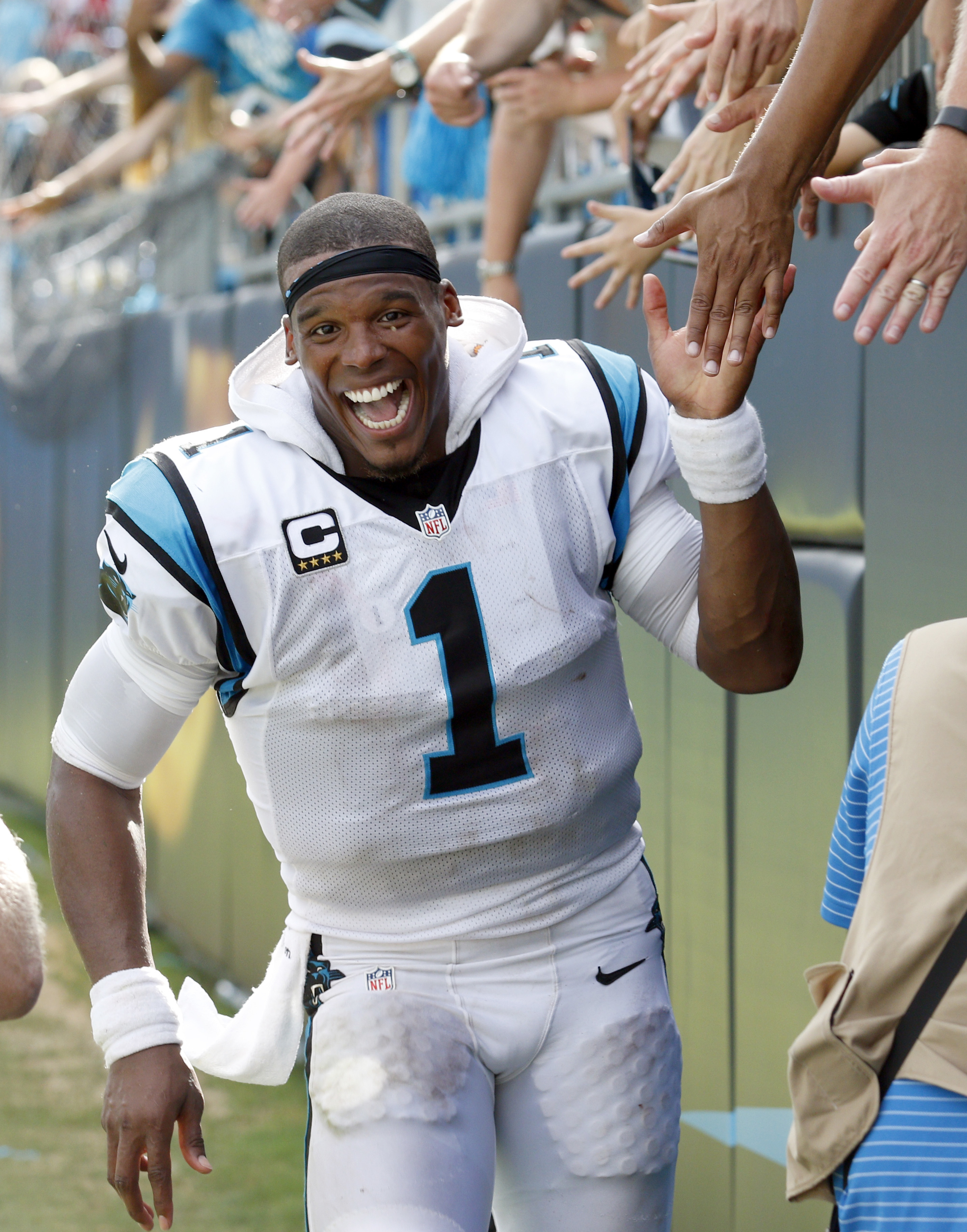 Carolina Panthers' Cam Newton (1) celebrates after an NFL football game San Francisco 49ers in Charlotte, N.C., Sunday, Sept. 18, 2016. The Panthers won 46-27. (AP Photo/Bob Leverone)