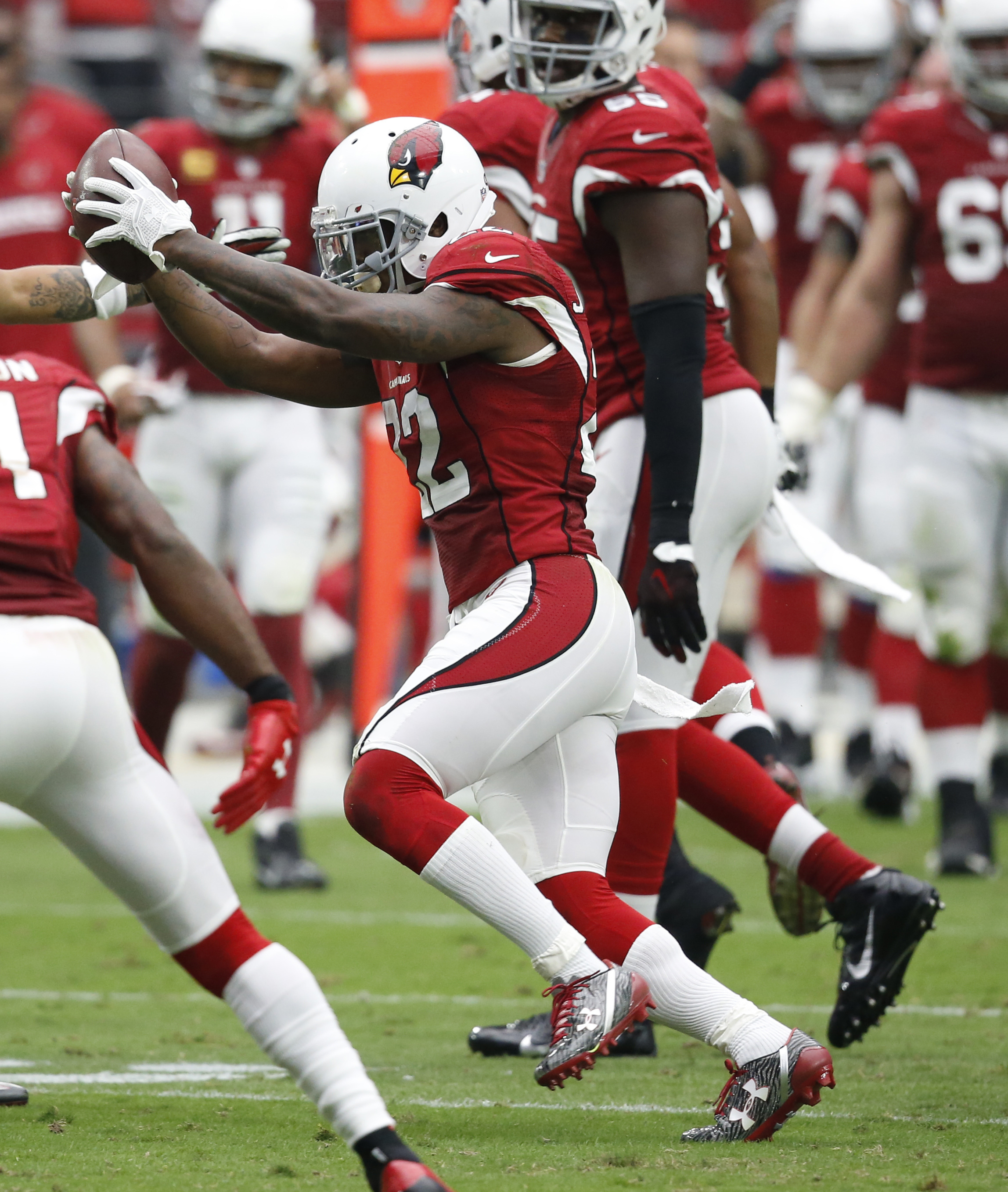 Arizona Cardinals strong safety Tony Jefferson (22) celebrates his fumble recovery against the Tampa Bay Buccaneers during the first half of an NFL football game, Sunday, Sept. 18, 2016, in Glendale, Ariz. (AP Photo/Ross D. Franklin)