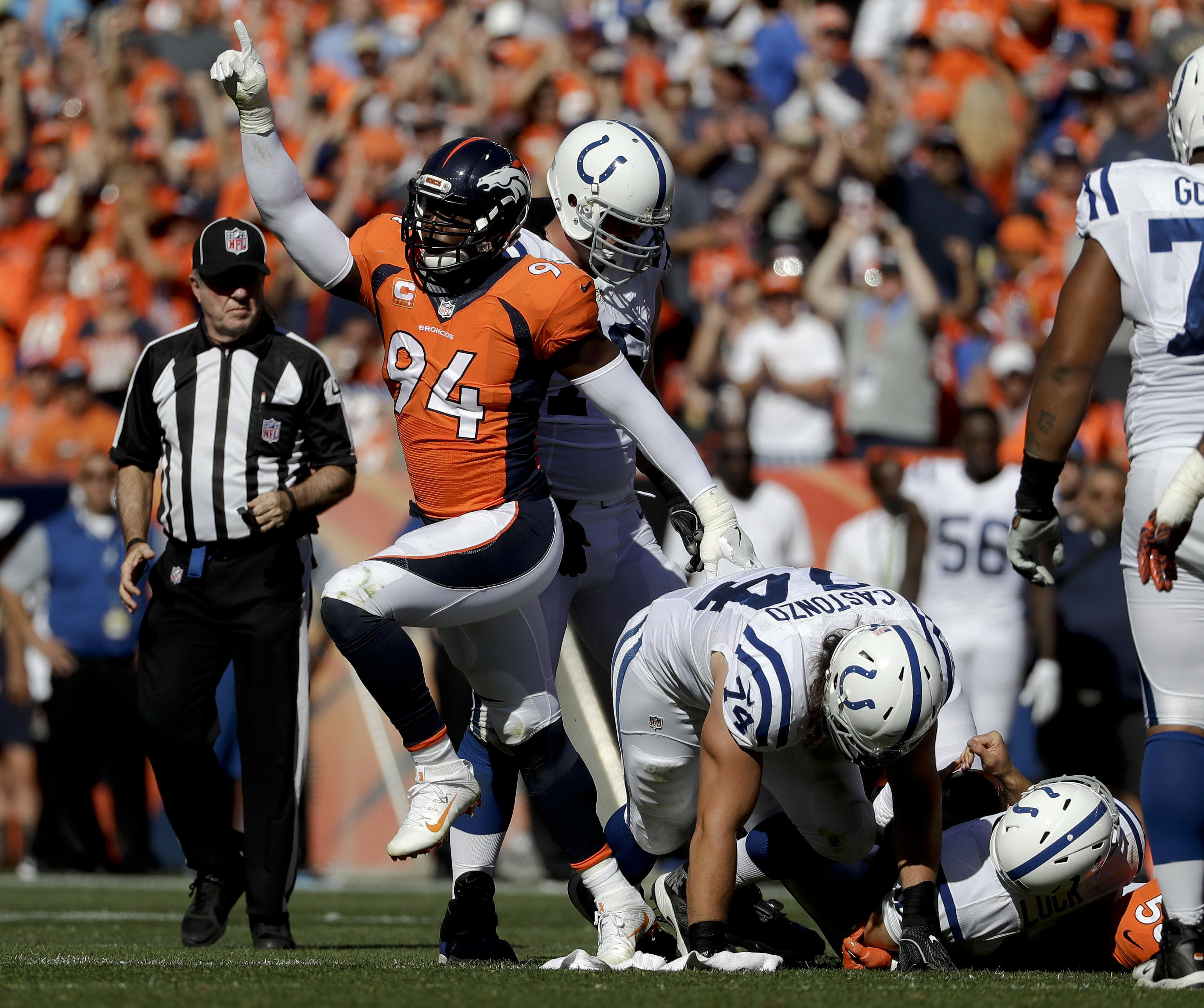 Denver Broncos outside linebacker DeMarcus Ware, left, celebrates after sacking Indianapolis Colts quarterback Andrew Luck during the first half in a NFL football game, Sunday, Sept. 18, 2016, in Denver. (AP Photo/Jack Dempsey)