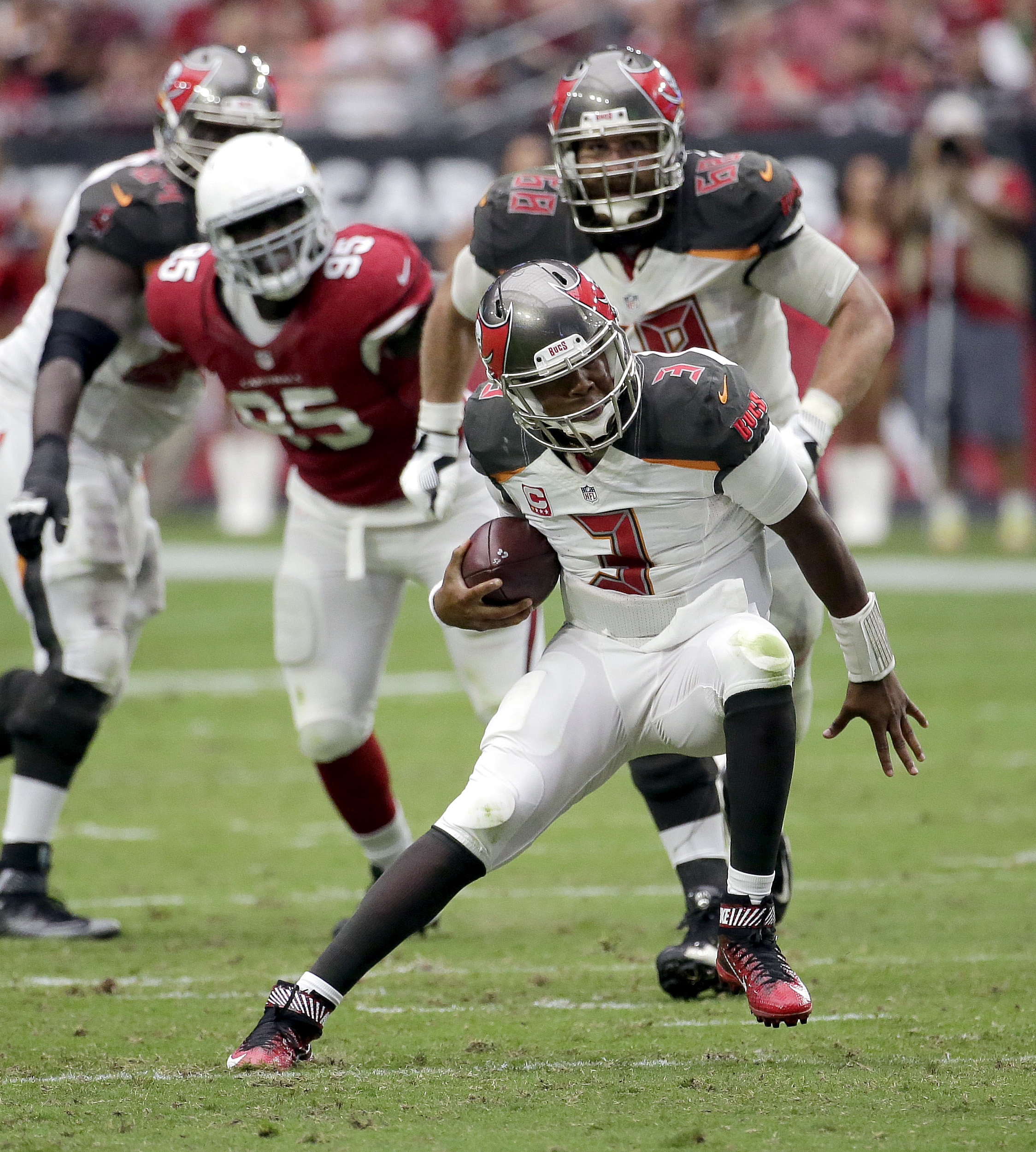 Tampa Bay Buccaneers quarterback Jameis Winston (3) scrambles against the Arizona Cardinals during the second half of an NFL football game, Sunday, Sept. 18, 2016, in Glendale, Ariz. (AP Photo/Rick Scuteri)