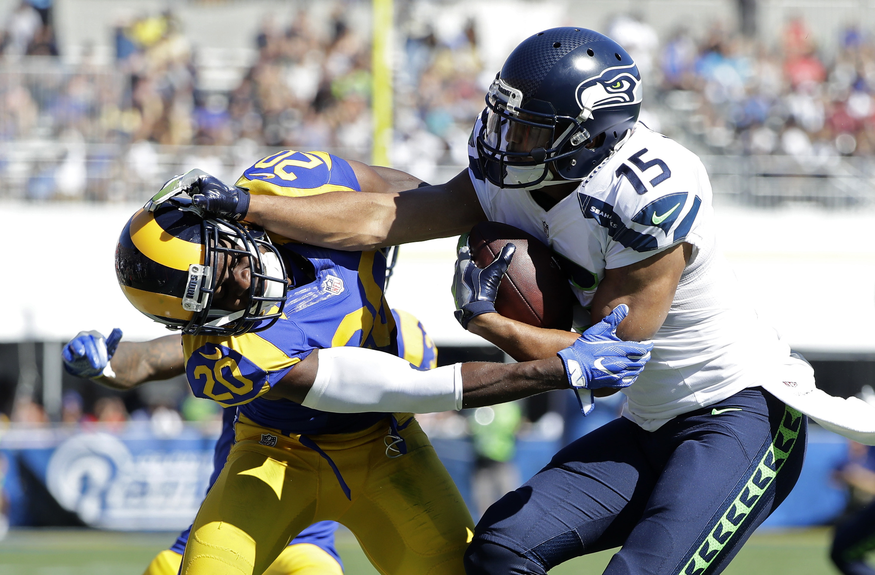 Seattle Seahawks wide receiver Jermaine Kearse, right, pushes Los Angeles Rams cornerback Lamarcus Joyner away as he runs the ball during the second half of an NFL football game at the Los Angeles Memorial Coliseum, Sunday, Sept. 18, 2016, in Los Angeles.