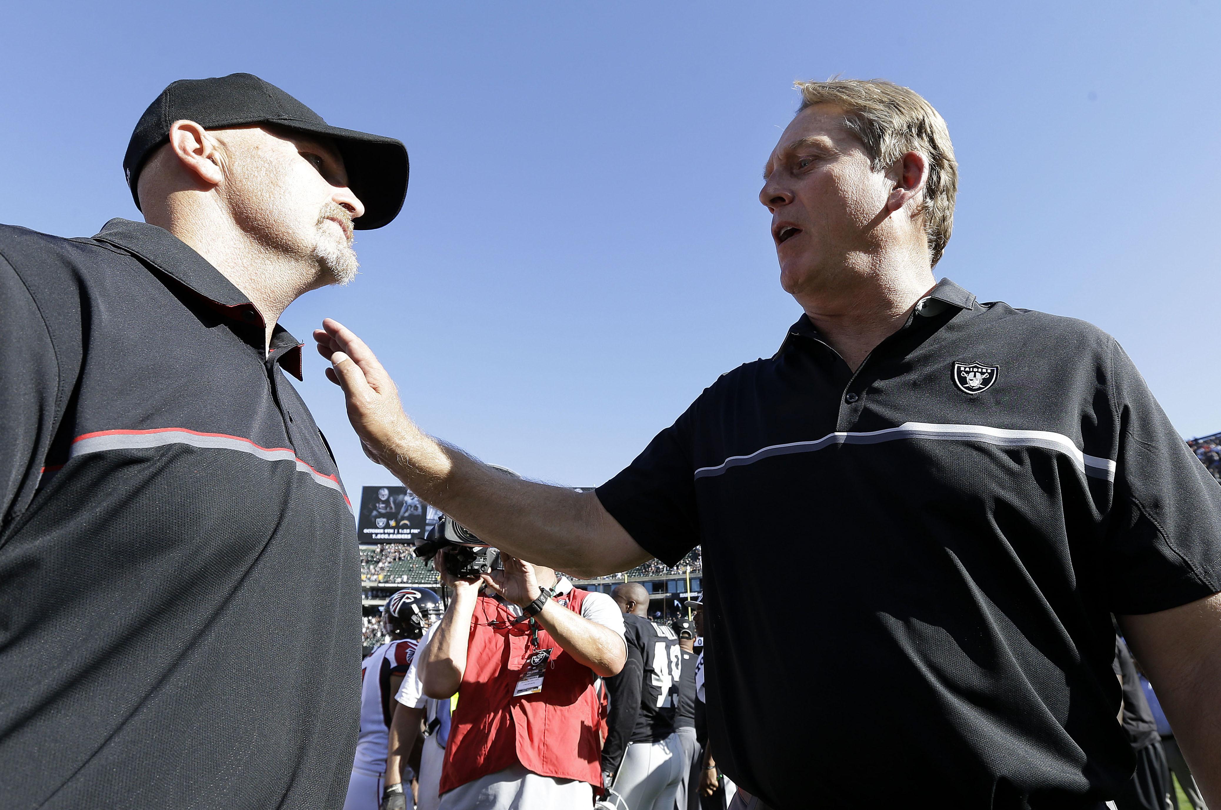 Atlanta Falcons head coach Dan Quinn, left, greets Oakland Raiders head coach Jack Del Rio after an NFL football game in Oakland, Calif., Sunday, Sept. 18, 2016. The Falcons won 35-28. (AP Photo/Ben Margot)