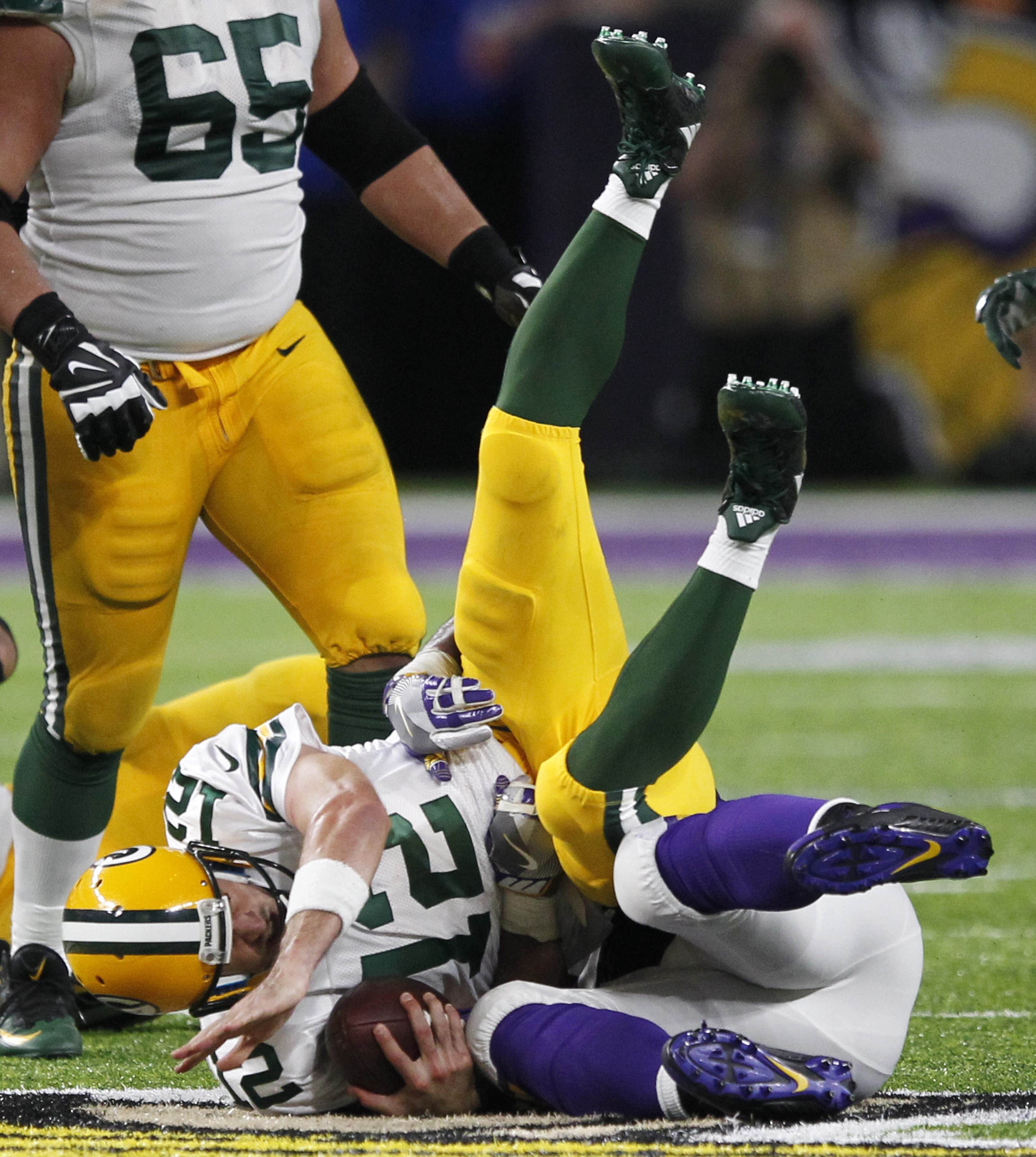 Green Bay Packers quarterback Aaron Rodgers (12) is sacked by Minnesota Vikings defensive tackle Tom Johnson, right, during the second half of an NFL football game Sunday, Sept. 18, 2016, in Minneapolis. The Vikings won 17-14. (AP Photo/Andy Clayton-King)