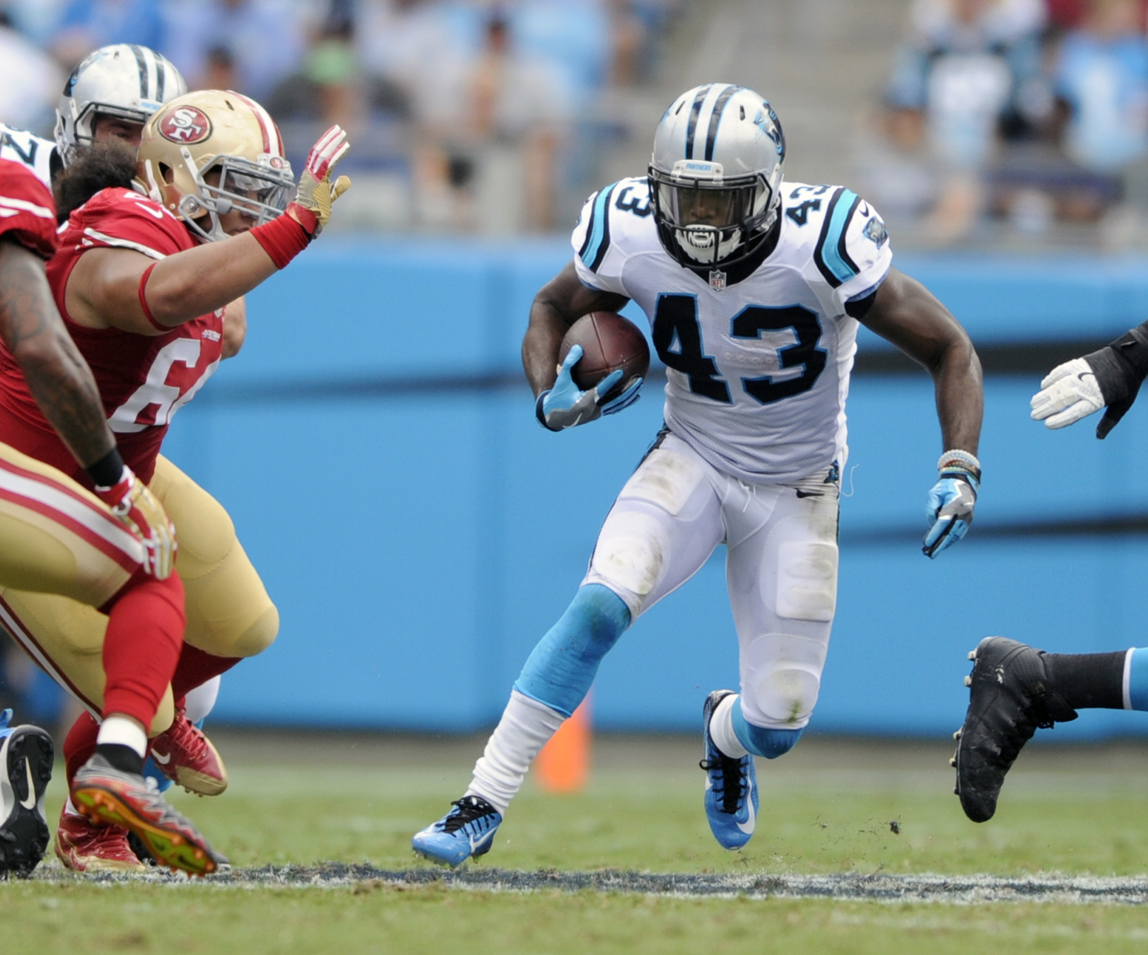FILE - In this Sept. 18, 2016, file photo, Carolina Panthers' Fozzy Whittaker (43) runs against the San Francisco 49ers in the first quarter of an NFL football game in Charlotte, N.C. The Panthers will have to turn to  Whittaker with Jonathan Stewart out