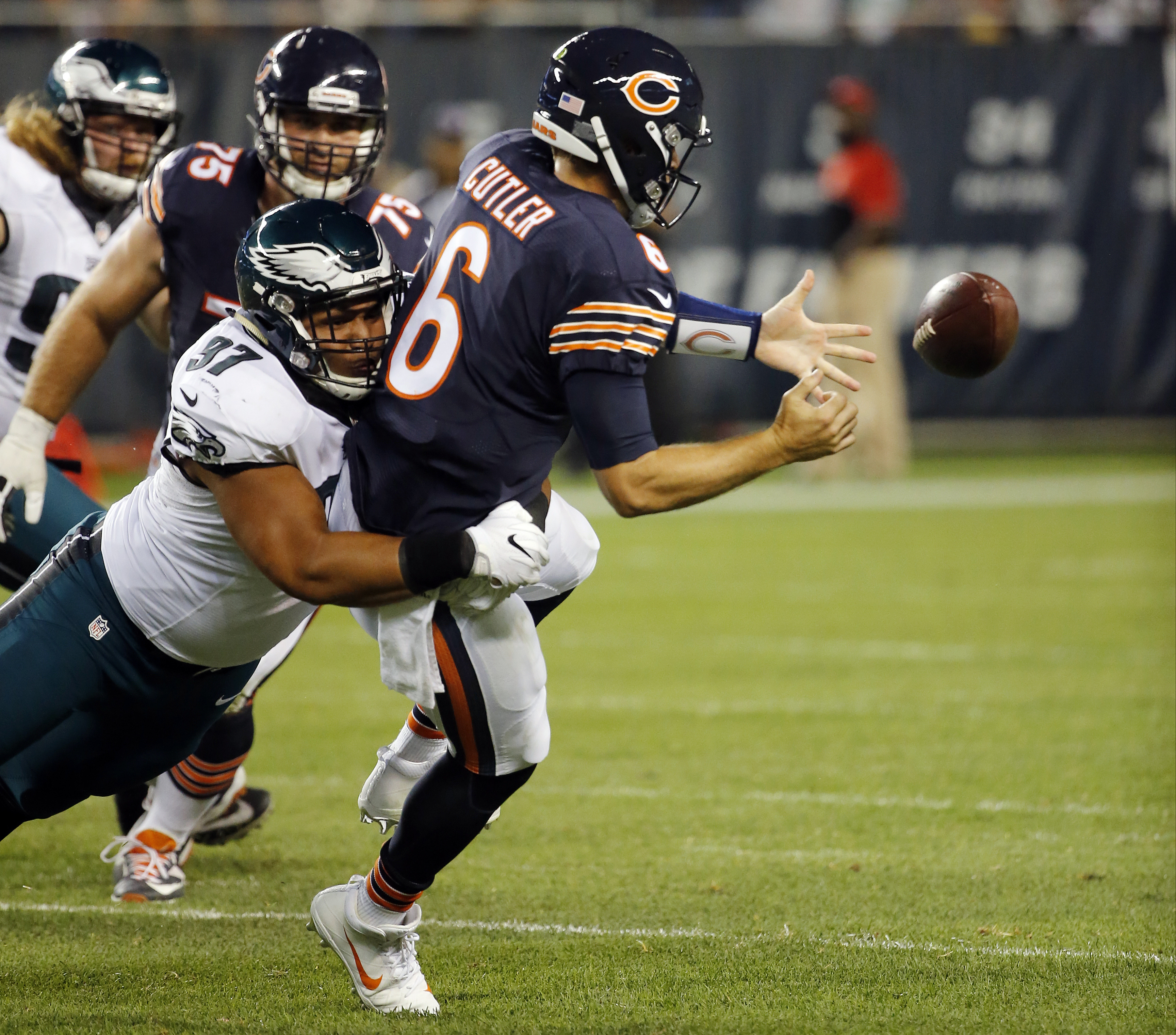Chicago Bears quarterback Jay Cutler (6) fumbles as he is tackled by Philadelphia Eagles defensive tackle Destiny Vaeao (97) during the second half of an NFL football game, Monday, Sept. 19, 2016, in Chicago. (AP Photo/Charles Rex Arbogast)