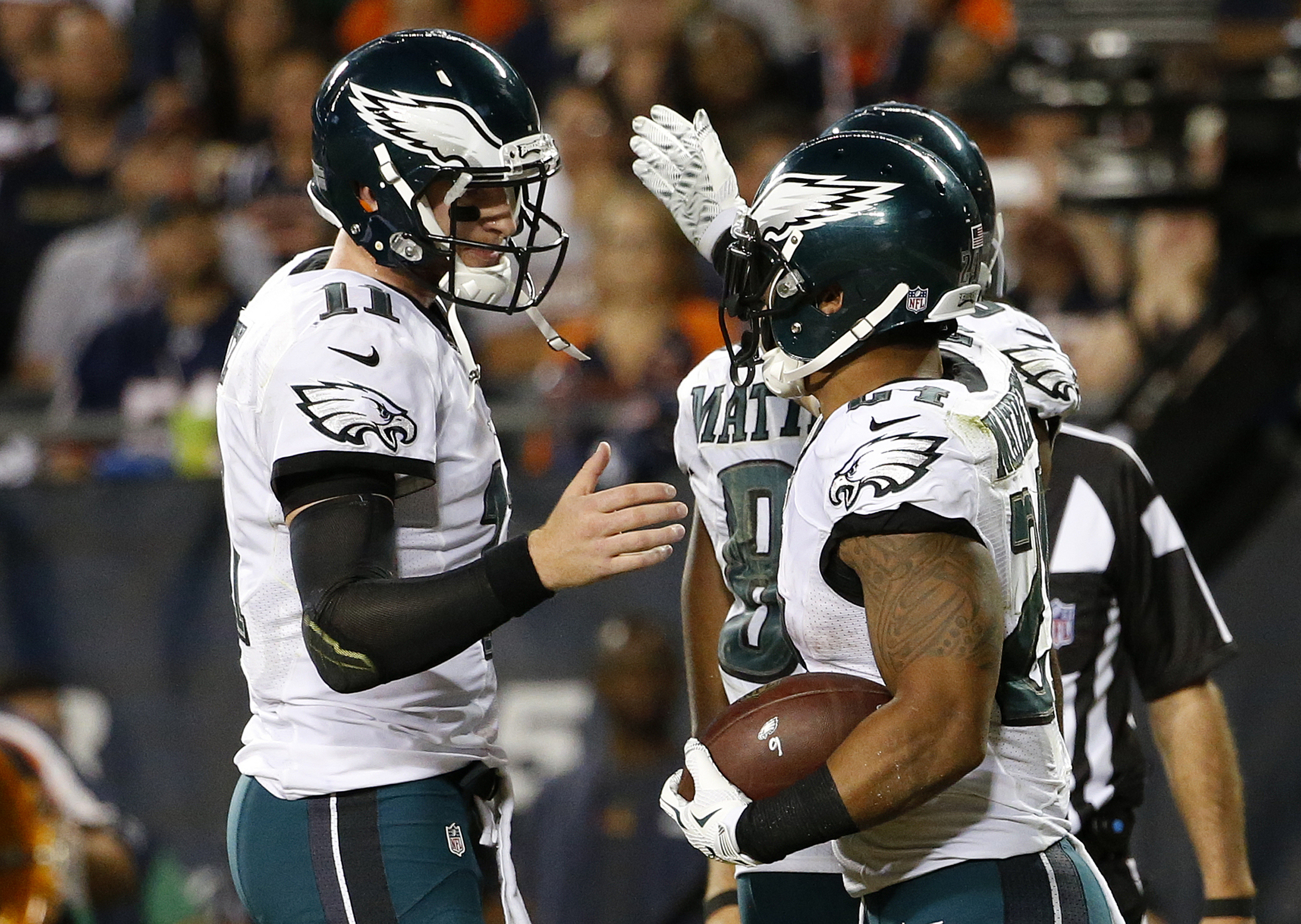 Philadelphia Eagles quarterback Carson Wentz (11) celebrates a touchdown with Philadelphia Eagles running back Ryan Mathews (24)during the second half of an NFL football game, Monday, Sept. 19, 2016, in Chicago. (AP Photo/Nam Y. Huh)