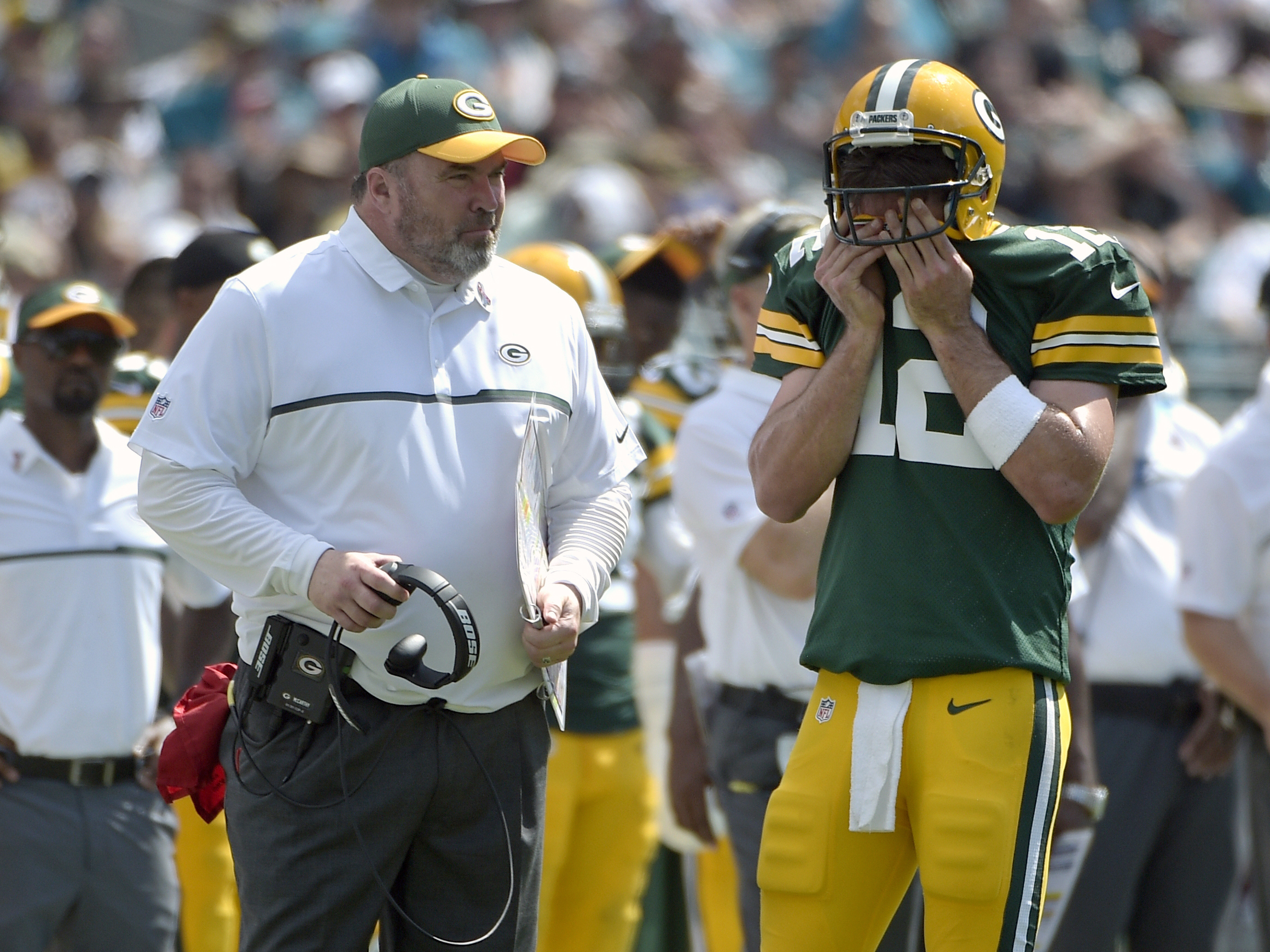 FILE - In this Sept. 11, 2016, file photo, Green Bay Packers head coach Mike McCarthy and quarterback Aaron Rodgers (12) chat on the sideline during the second half of an NFL football game against the Jacksonville Jaguars in Jacksonville, Fla. McCarthy is